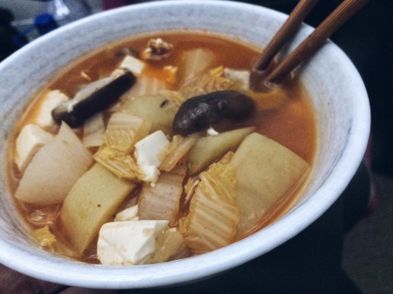 Last night's dinner: Kimchi Soup, with potato, white radish, shiitake mushrooms, tofu, and cabbage