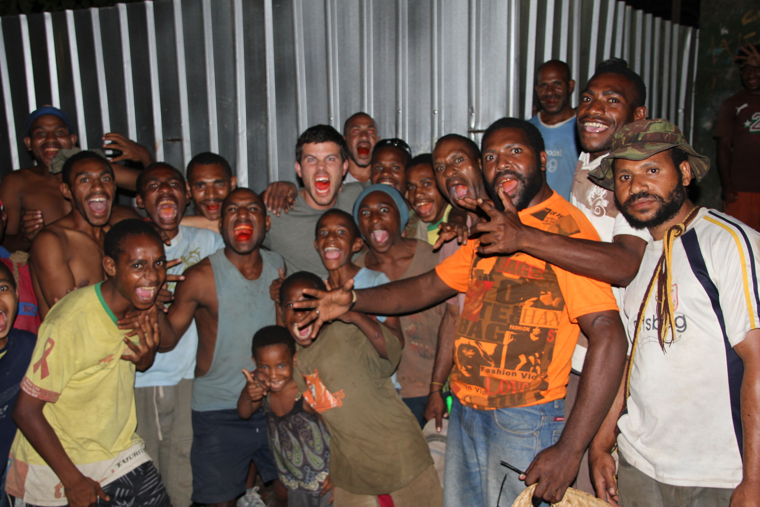 Eric Hill chewing betel nut with locals from the infamous Erema 'Candlelight City' in Port Moresby