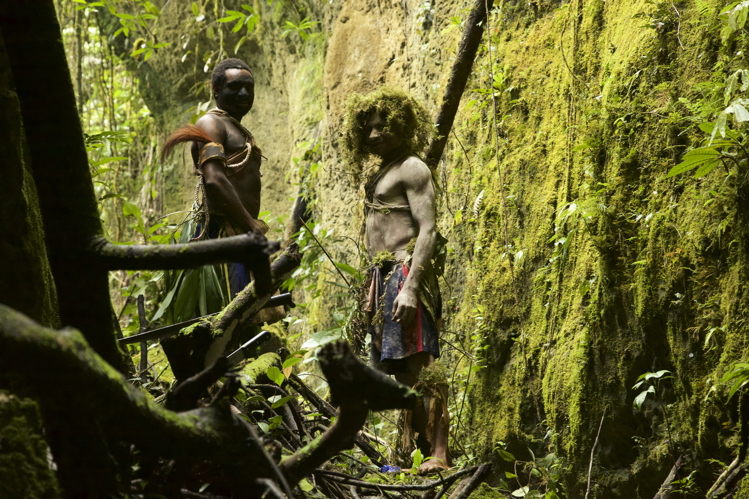 Kosua boys from Obote Cave camp putting on a show a the entrance to the cave.