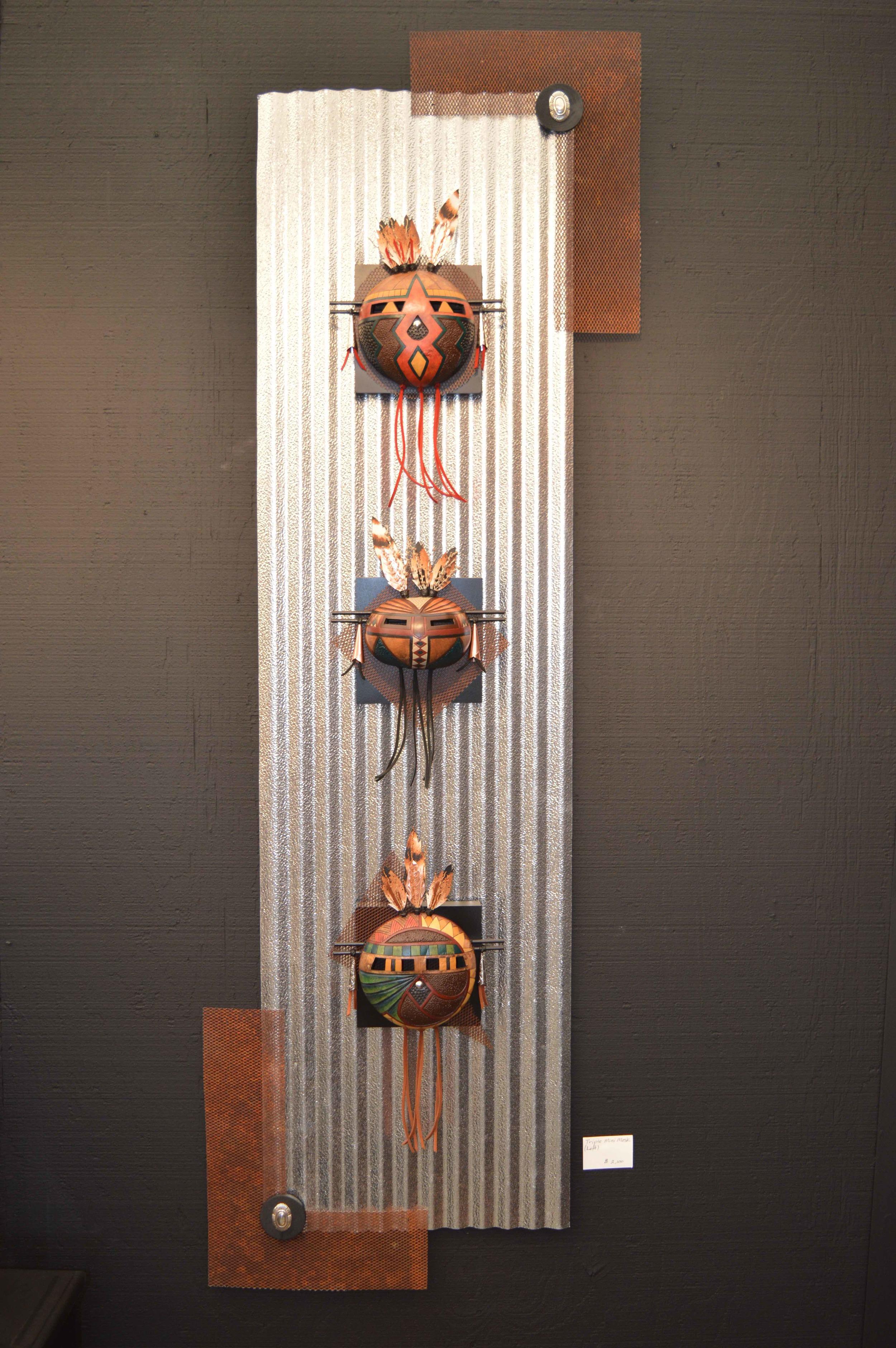 Three mini masks on metal.jpg