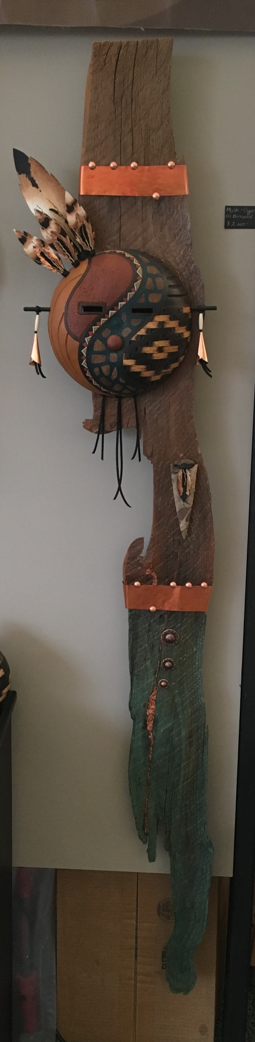 Mask on repurposed barn wood