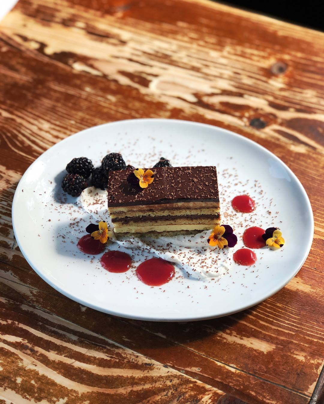 opera cake: pink peppercorn spongecake • chocolate-balsamic syrup • almond buttercream • chocolate-balsamic ganache • chocolate-red wine glaze • pink peppercorn chantilly cream • strawberry-port gel