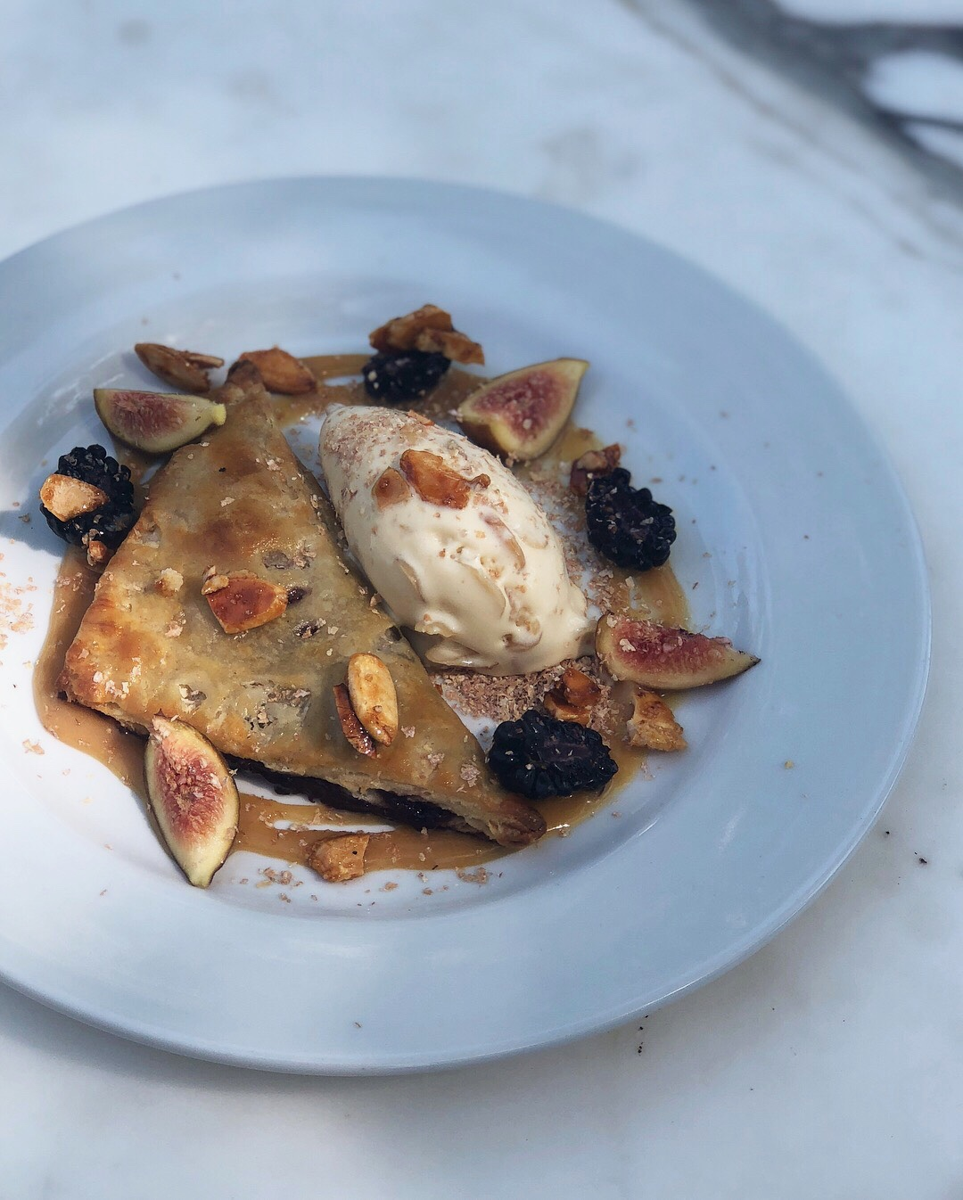 blackberry handpie • toasted almond ice cream • caramel almonds • burnt soy honey • blackberries • figs • bran flakes
