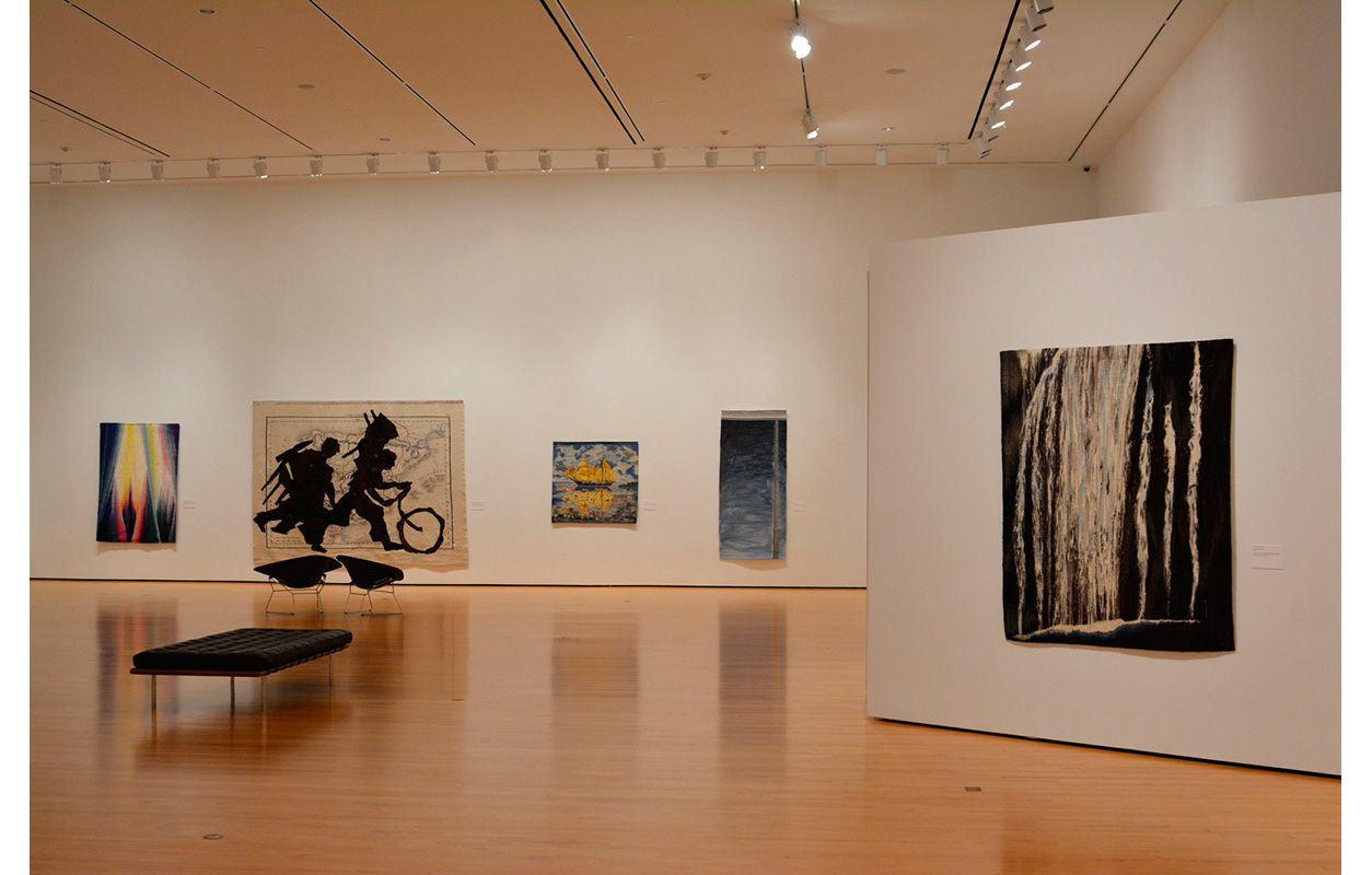 New Art of the Loom: Contemporary International Tapestries, 2013 , Hillard University Art Museum, University of Louisiana at Lafayette. Far right,  Falling Water Tapestry,  (Background, 2nd from left, William Kentridge Tapestry)