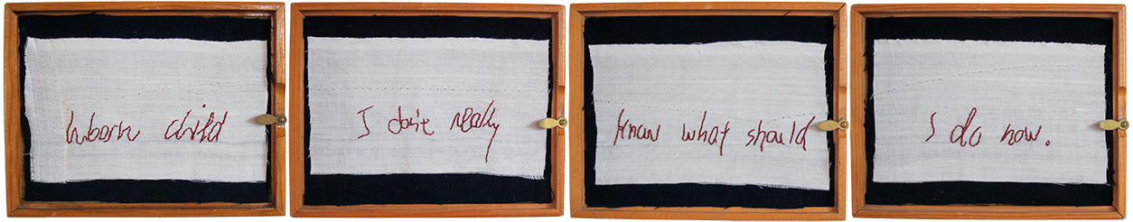 "Unborn Child 1 , Embroidery on Linen in found Wooden Gem Box, 6.5"" x 5.625"" x 1.375"" each box, 6.5"" x 35"" x 1.375"" all  Inspired by a   note found on the Ladies' room floor   at the Museum of Modern Art, in New York"