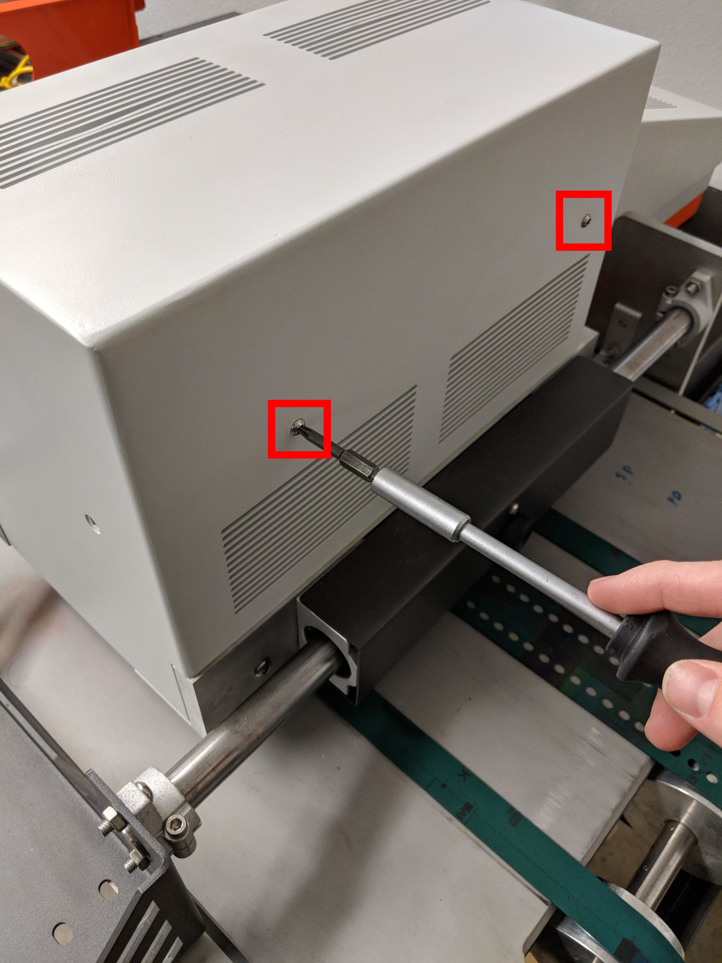 Figure 6: Left cover removal - button head screws