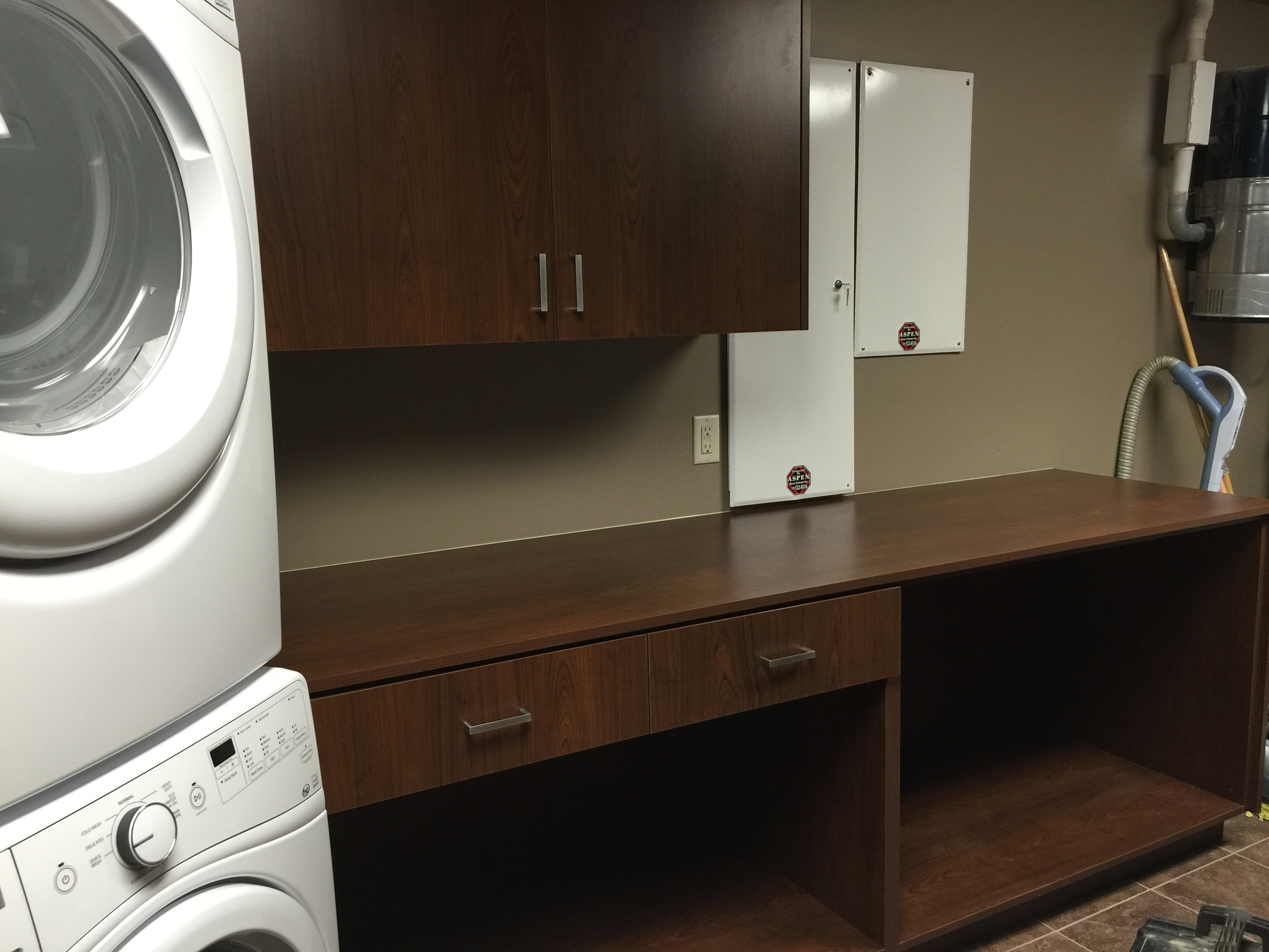 Laundry room folding counter with storage