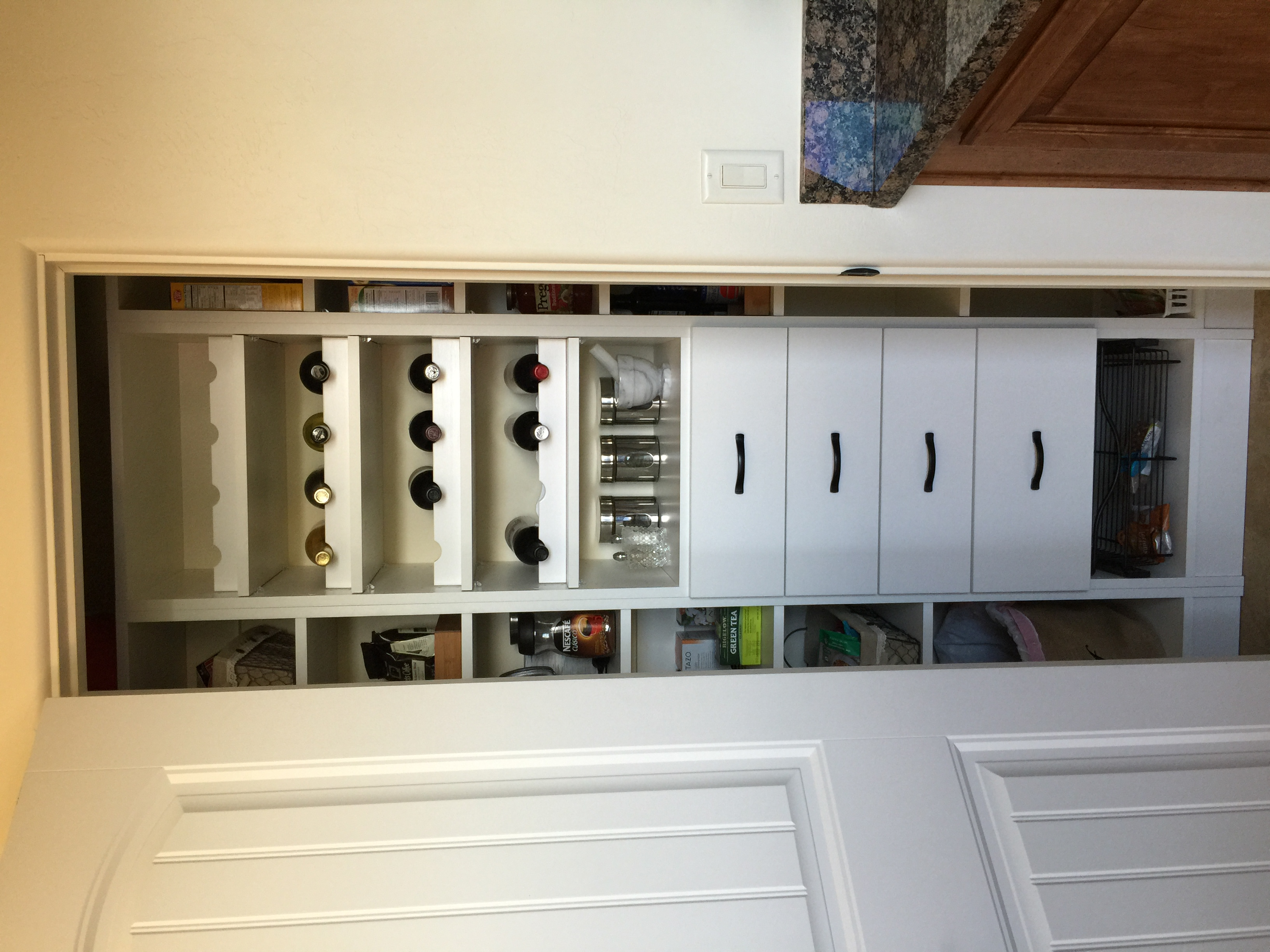 Pantry with shelves and wine racks