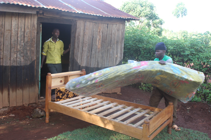 After realizing the sponsored kids in the village were sleeping on boards, we got them some new, comfortable beds.