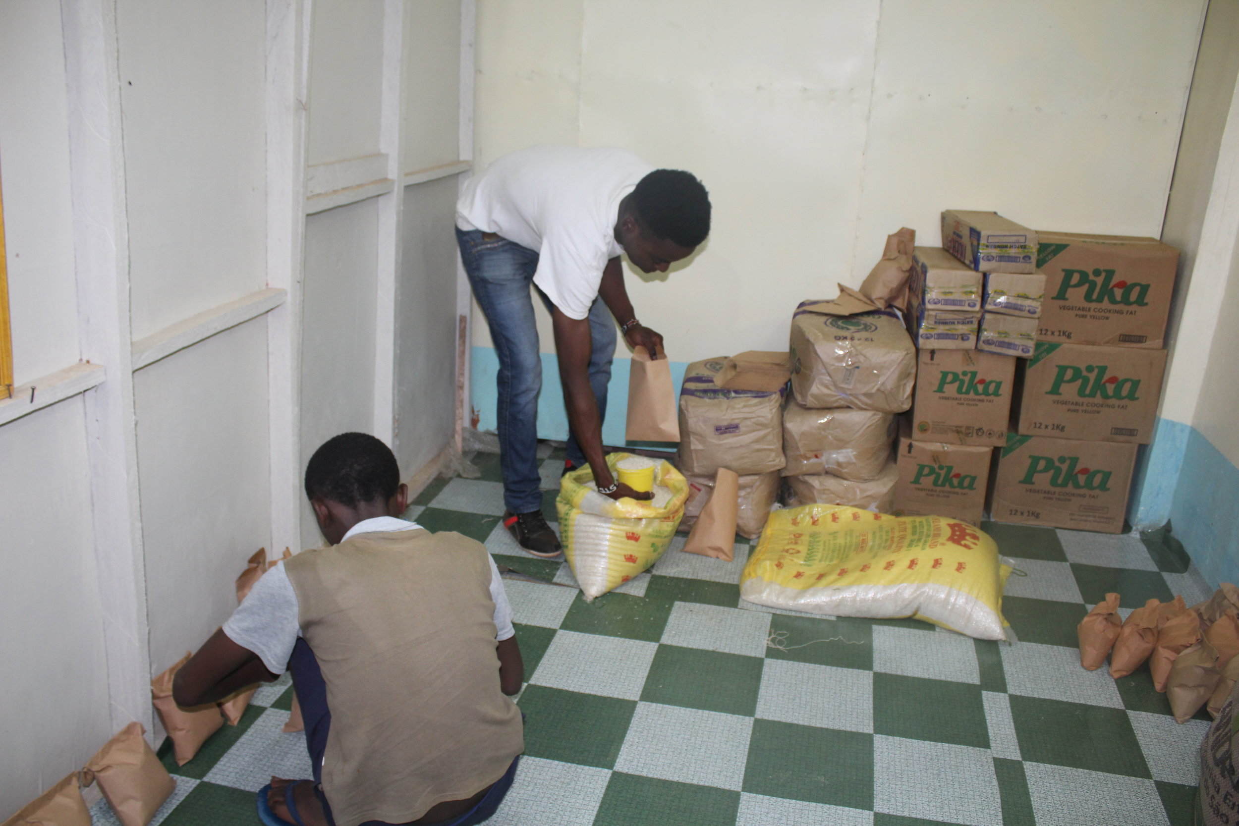 The sponsored kids helped organize and distribute food for village households caring for orphans.