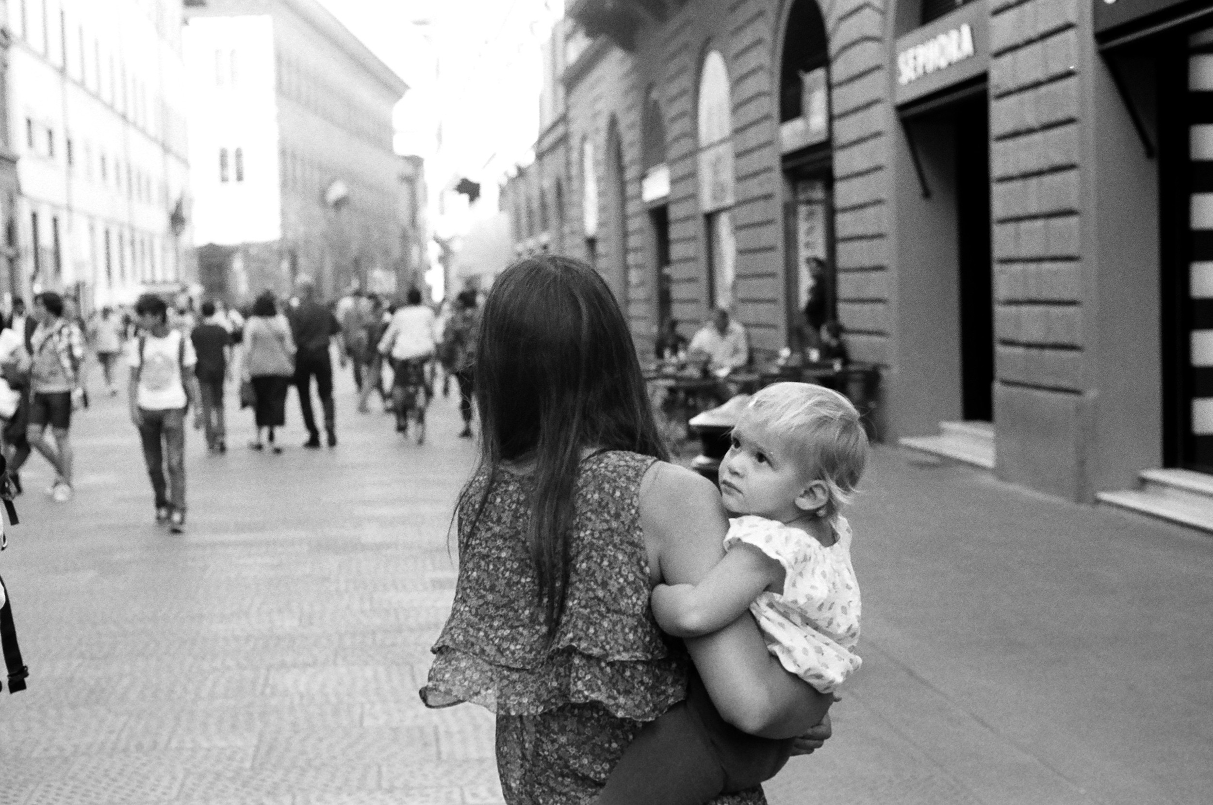 A baby and her mom doing some afternoon shopping
