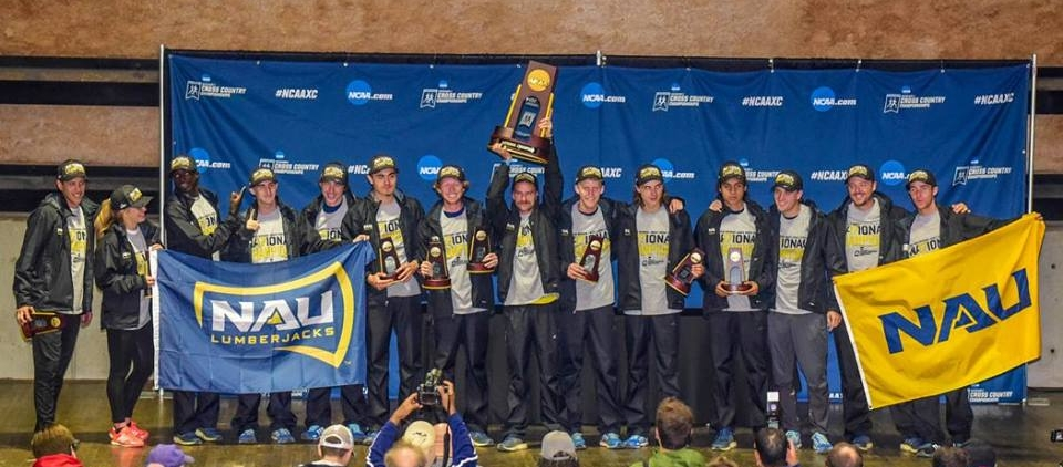 Head Coach Mike Smith (far left) & the Northern Arizona University Men's Cross Country celebrate their 2nd consecutive national title after winning the 2017 NCAA National XC Championship with a dominate 74 point run.  Photo Credit:   Mike Scott