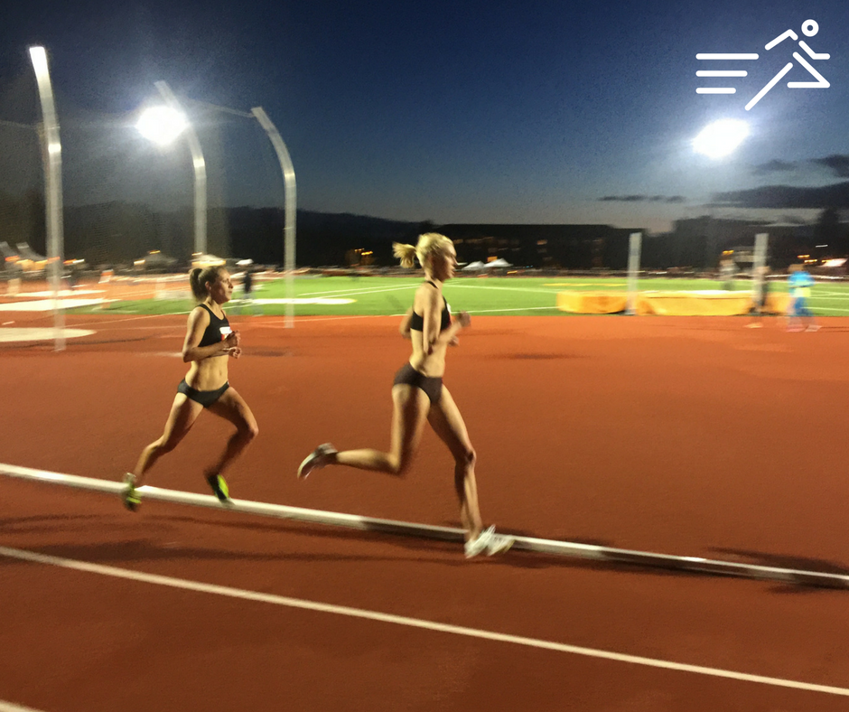 Nicole Blood (a member of High Performance West from October 2015 - December 2016; pictured left)is paced by HPW teammate  Eleanor Fulton (right) en route to winning the 2016 Oregon State High Performance Women's 5,000m in 16:21.65 on windy Springtime evening in Corvallis, Oregon.