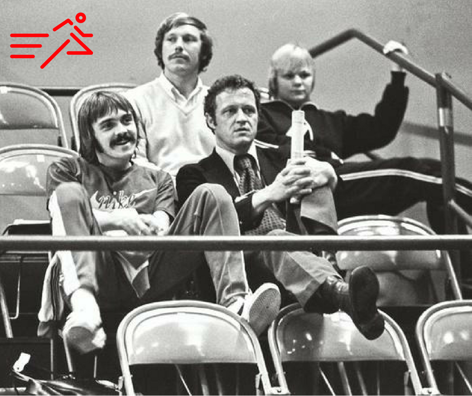 Coach and Olympian, Bill Dellinger (right;front) seated next to one of his runners, Olympian Steve Prefontaine (left; front).