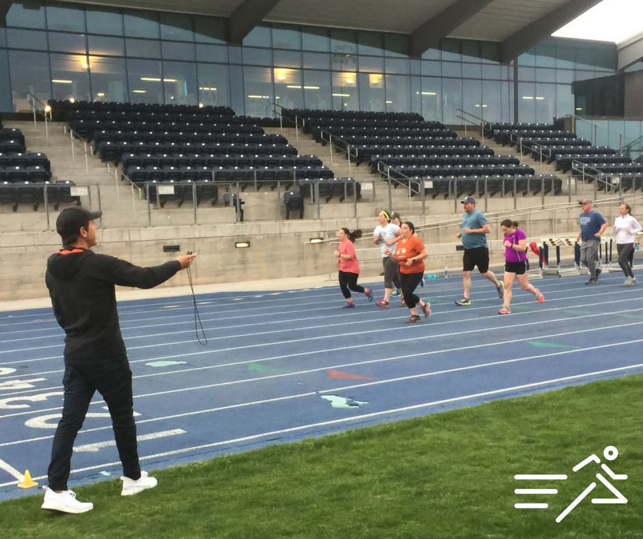 NAU Director of Cross Country and Track & Field  Mike Smith  holds the stopwatch, encourages, and coaches runners of all abilities at the Run Flagstaff Tuesday Track Workouts. He does this every week in addition to his duties as head of the Lumberjax program.