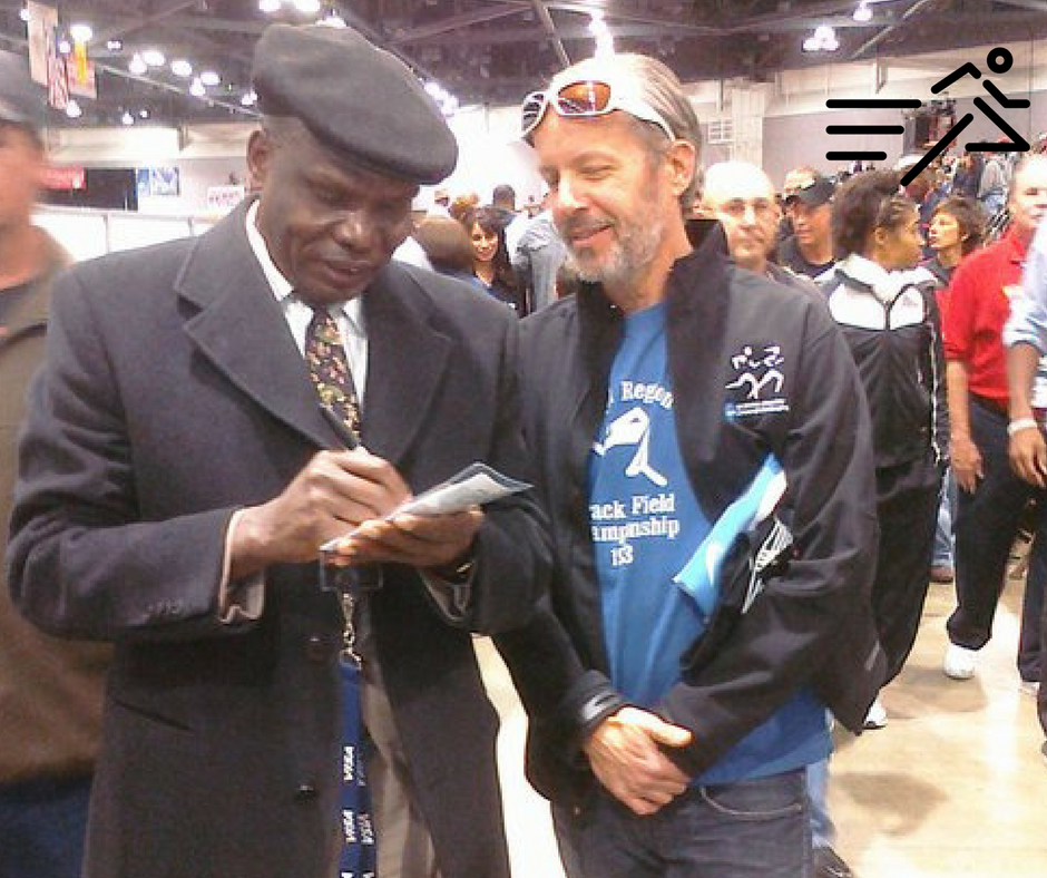 The great Henry Rono (left) signs an autograph for University of Portland Men's Cross Country / Track & Field Head Coach Rob Conner (right), circa 2011.