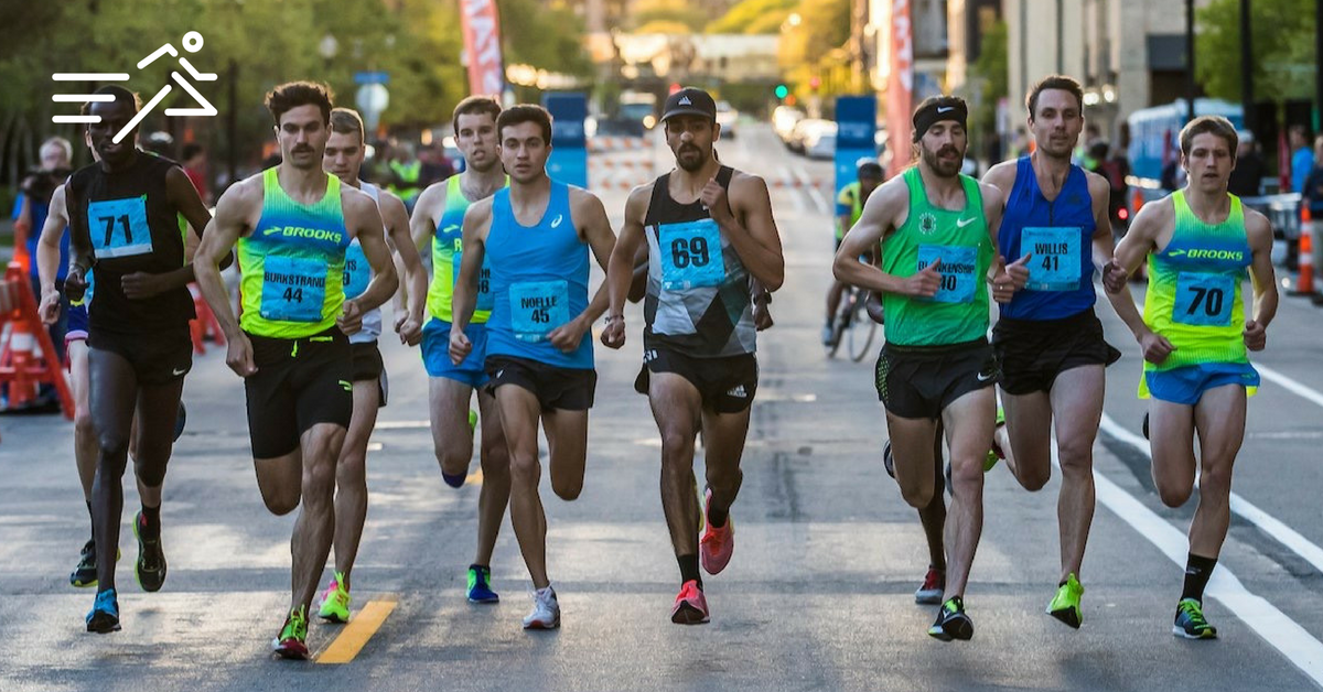 Daniel Herrera (bib 69) engages a very capable field at the 2017 Medtronic Twin Cities 1 Mile Road Race where he placed 2nd.