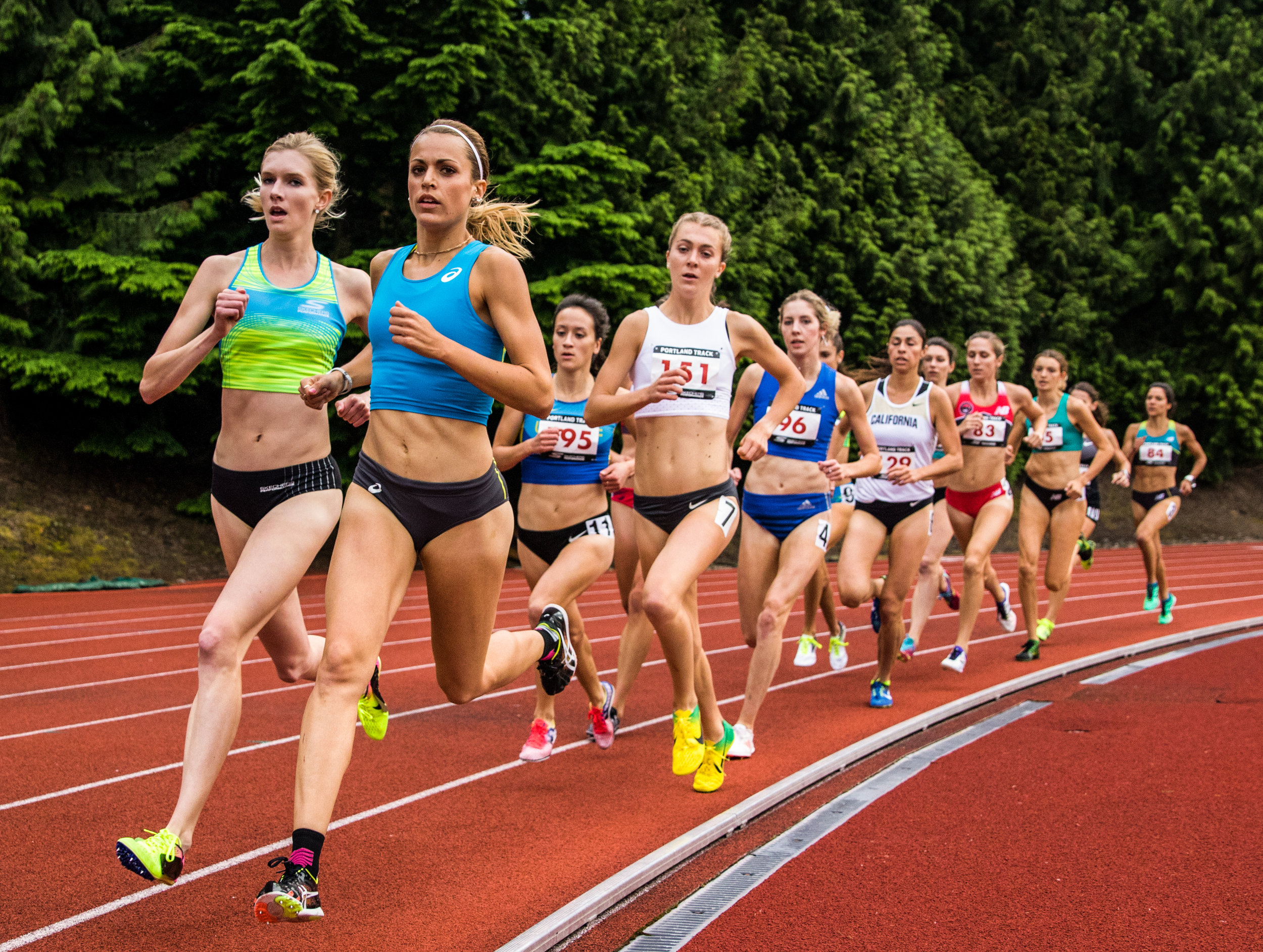 Eleanor Fulton (green/blue top) of High Performance West leads the charge as the rabbit at the 2017 Stumptown Twilight in the High Performance Women's 1500m.