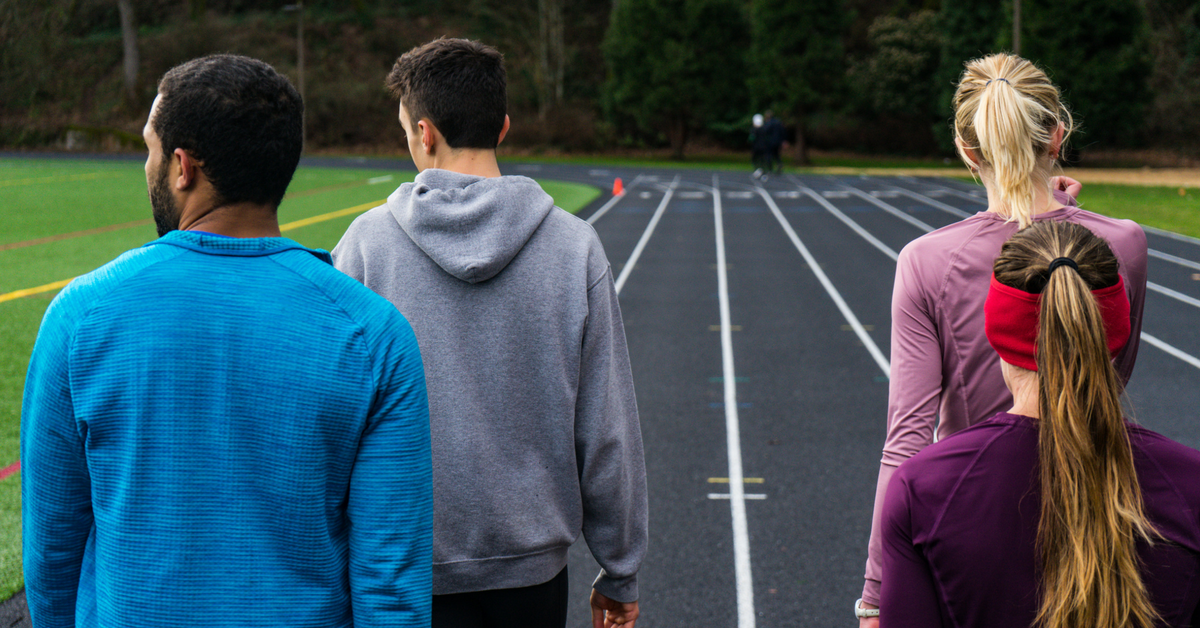 Members of the middle distance corps of High Performance West Elite readying for the workout's next rep.