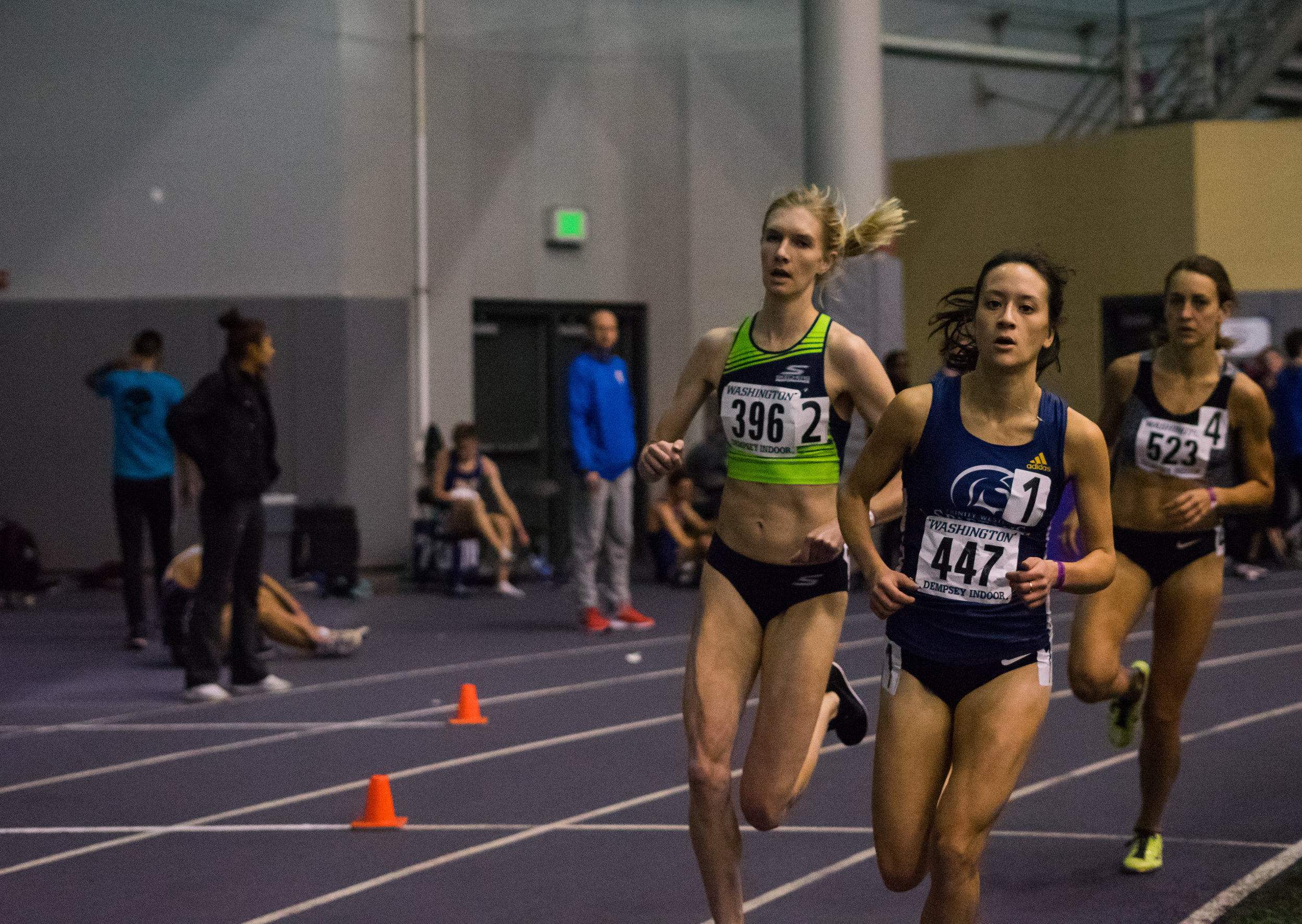 HPW Elite miler, Eleanor Fulton (#396), pictured racing her way to a personal best of 4:34 for the indoor 1 mile during the 2018 season.