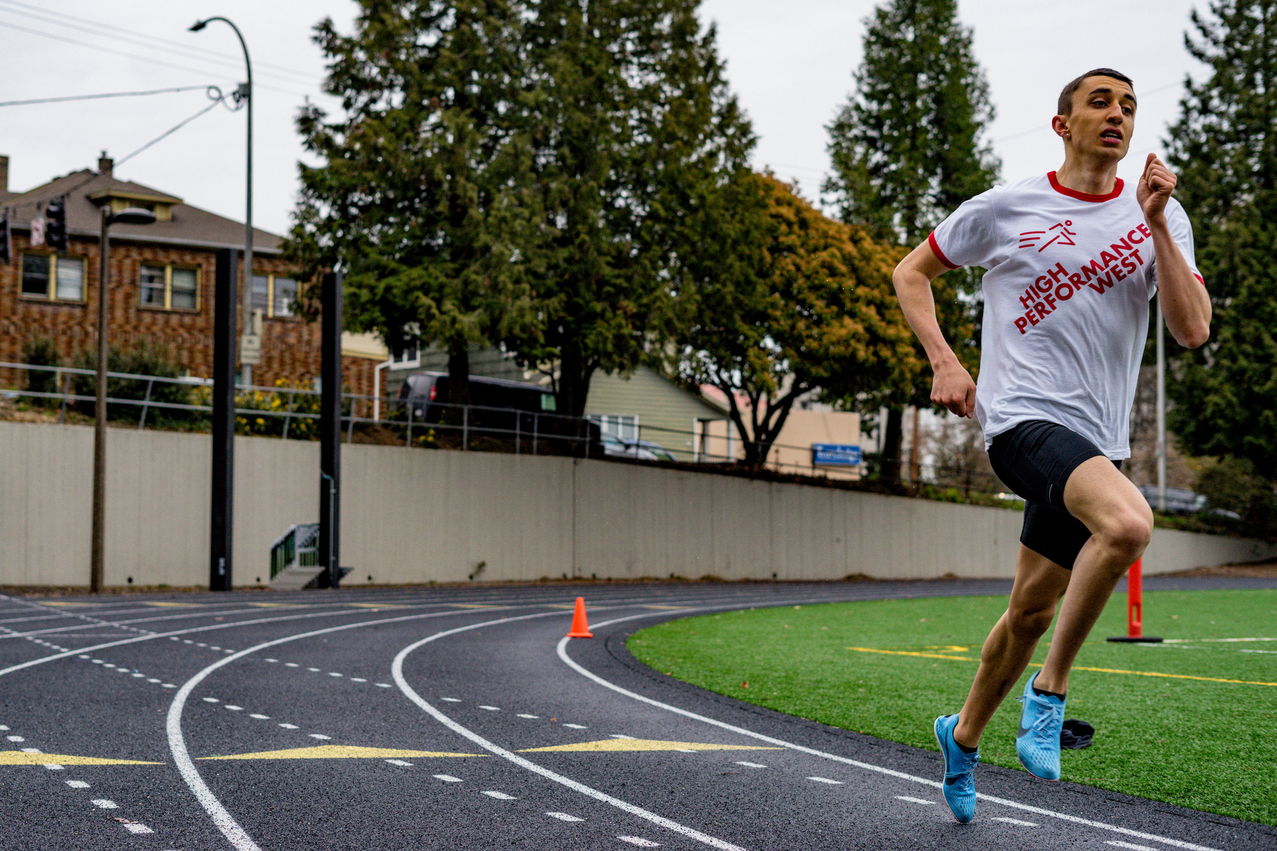 """HPW Elite 800m man, Nathan Fleck, training to learn in the High Performance West """" Work Shirt ."""""""