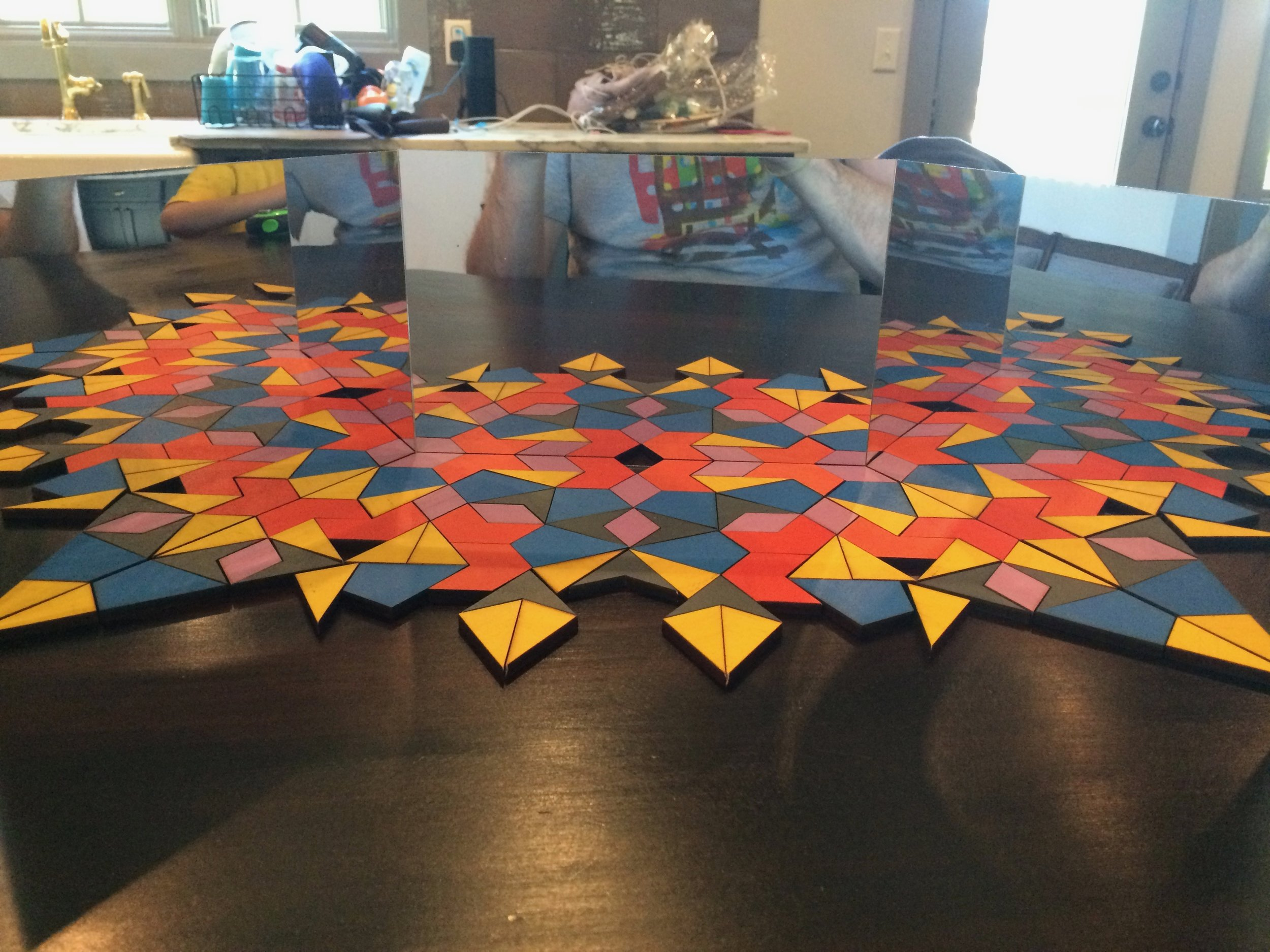 Something I made with pattern blocks and mirrors.