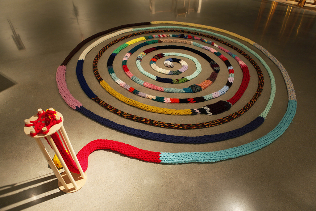 (10)Mallory Donen_The Machine_Knitting Ouroboros_13ft Wide.jpg