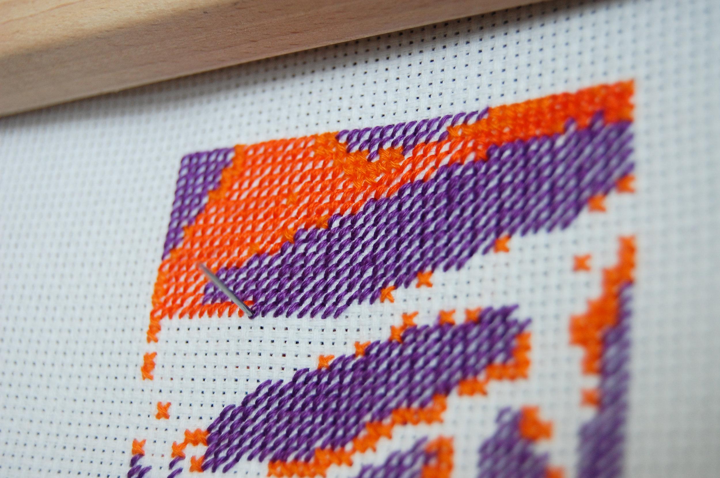 Detail shot of  Translation #1  cross-stitch in progress.