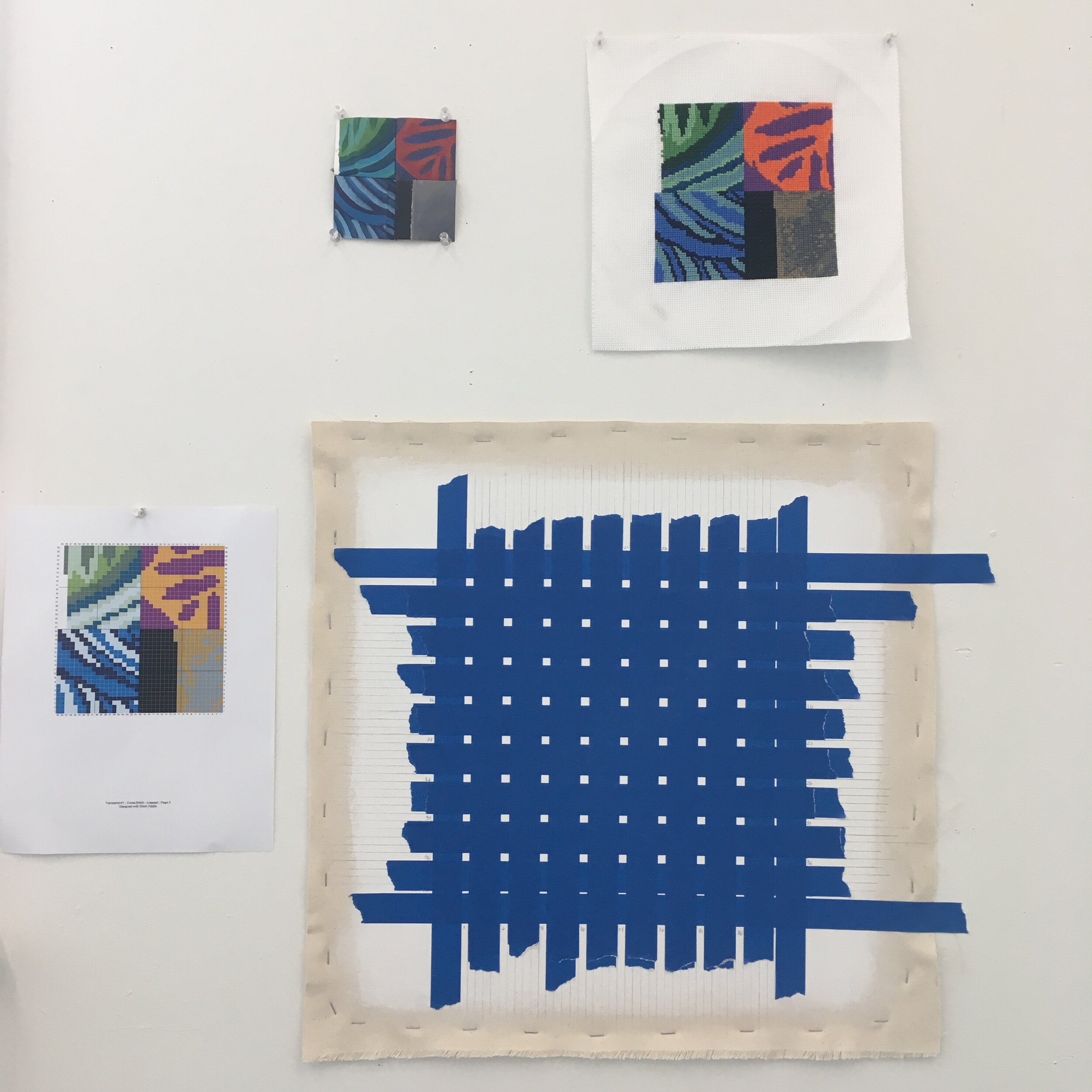 After taping off the canvas, 64 1/2 inch squares were exposed at one time. To the left of the canvas is the cross-stitch pattern I followed to do the painting.