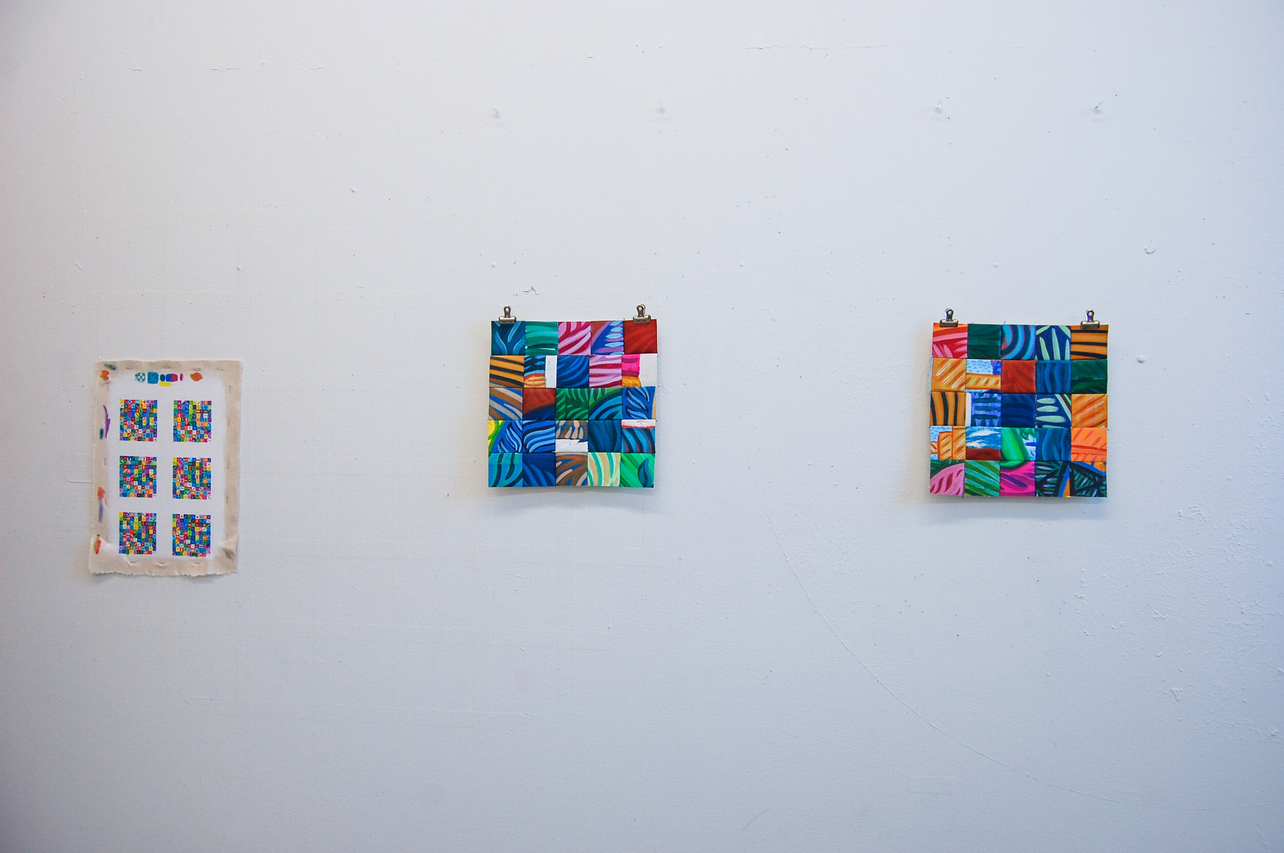 Untitled  (Left), 2019, gouache, canvas, 2.5 x 2.5 inches (each square),  Pattern B  (Middle), 2019, canvas, embroidery floss, graphite, 9.5 x 9.5 inches,  Pattern A  (Right), 2019, canvas, embroidery floss, graphite, 9.5 x 9.5 inches