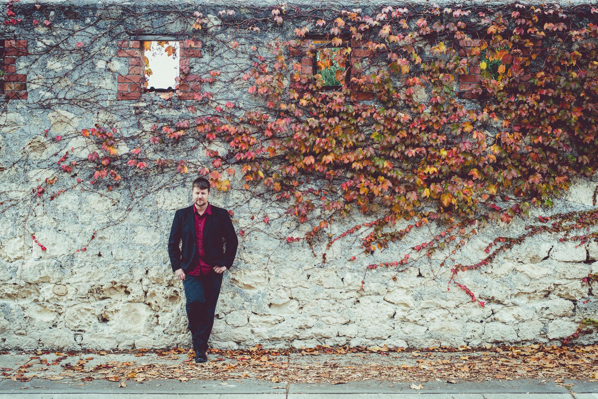 Stewart in front of wall.jpg