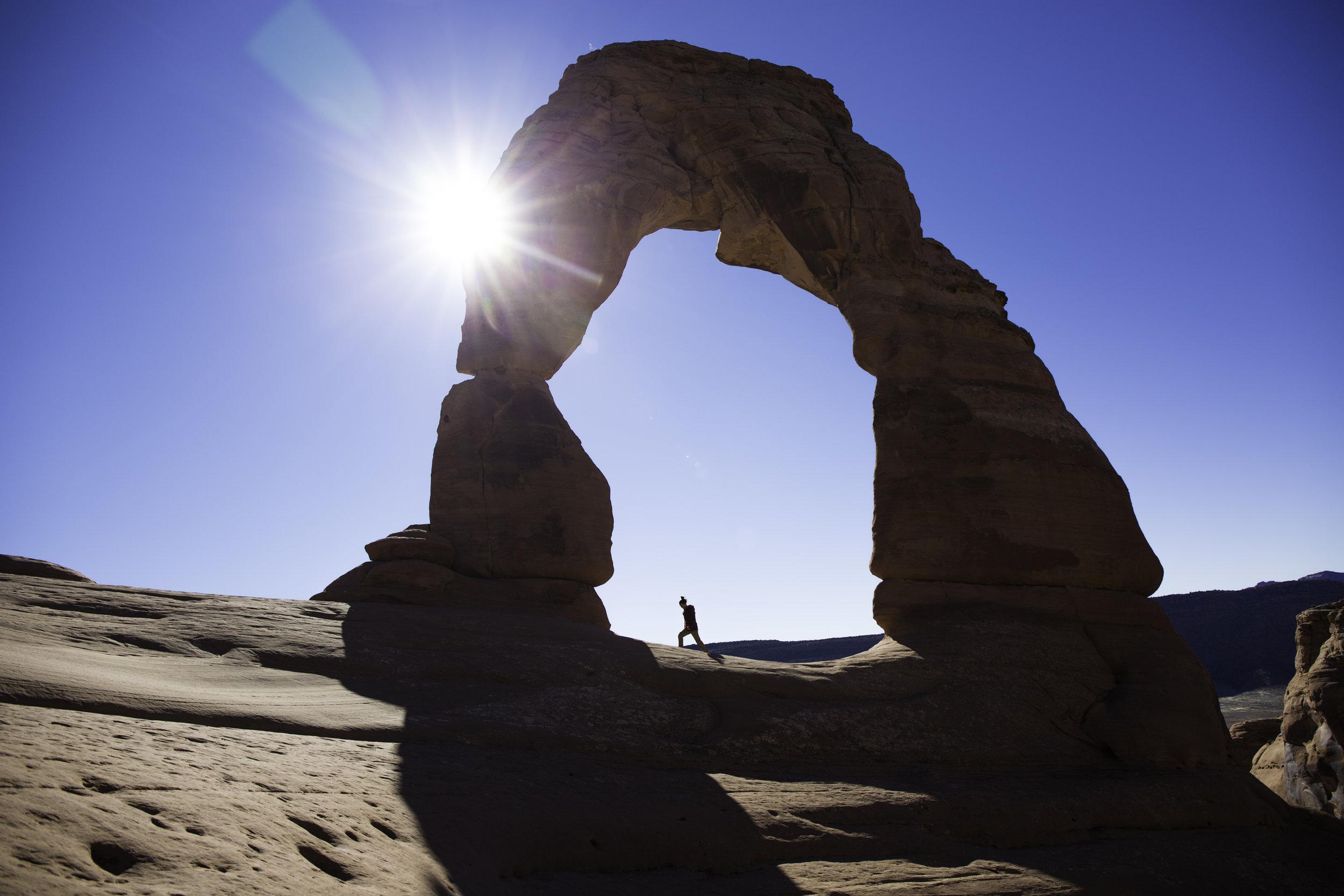 Kayla walking below Delicate Arch