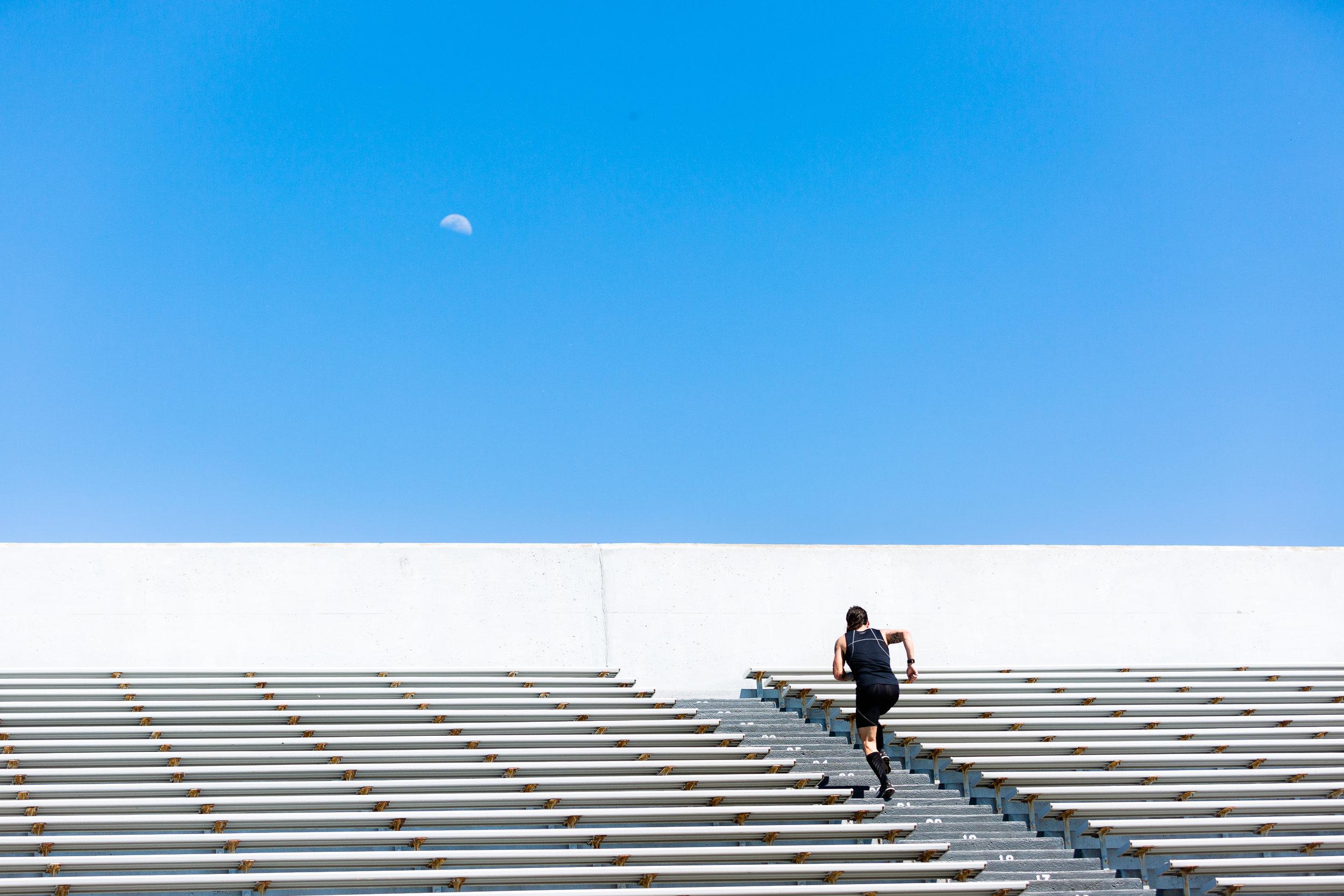 Mullet Man aka Kyle Dietz runs towards the moon in Davenport, IA.