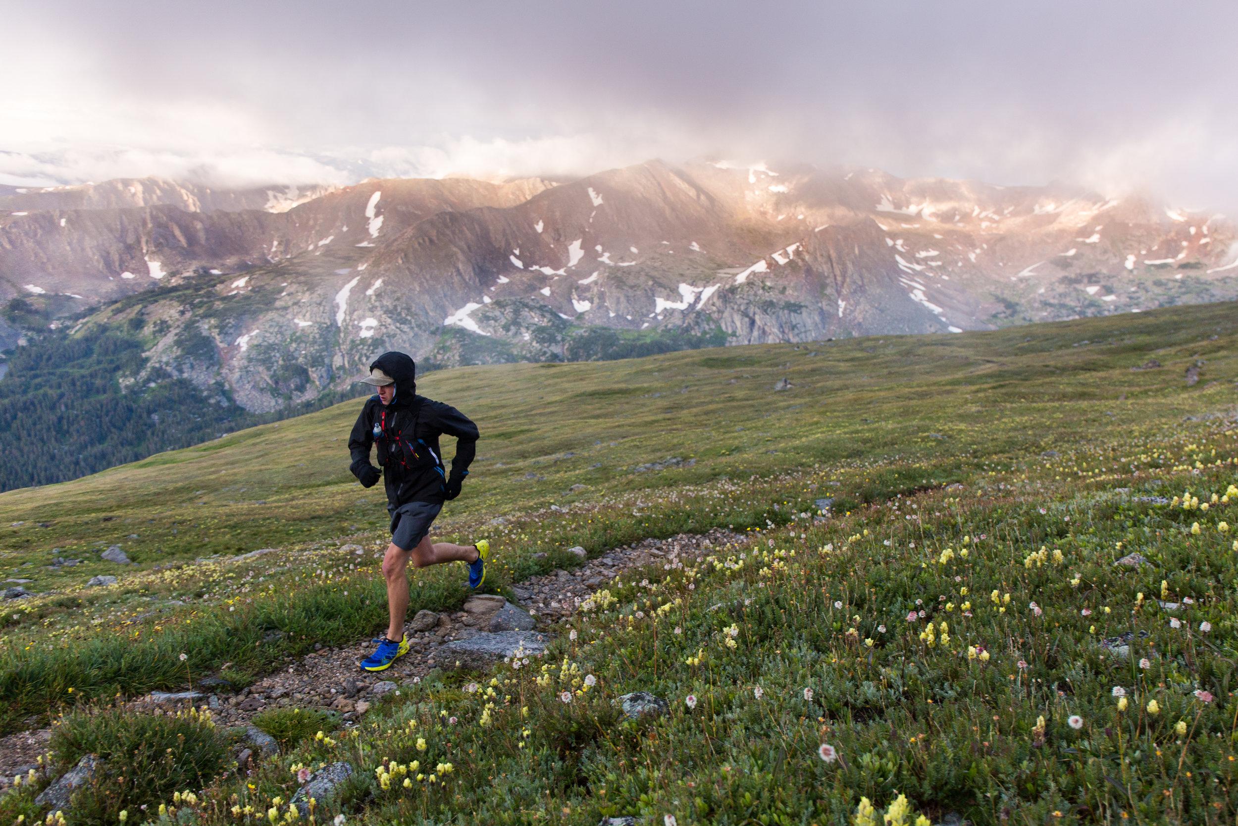 Evan Valencia mid-run up South Arapaho Peak in Indian Peaks Wilderness.