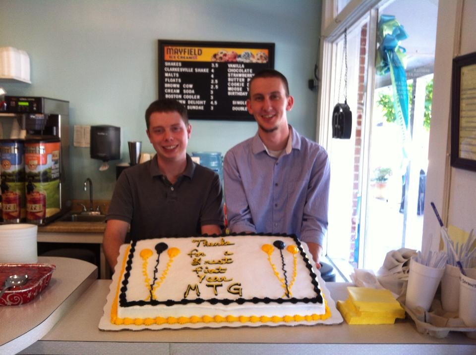Andrew (left) and Preston celebrate Midtown Grill's One Year Anniversary with friends, and family. -August 2014