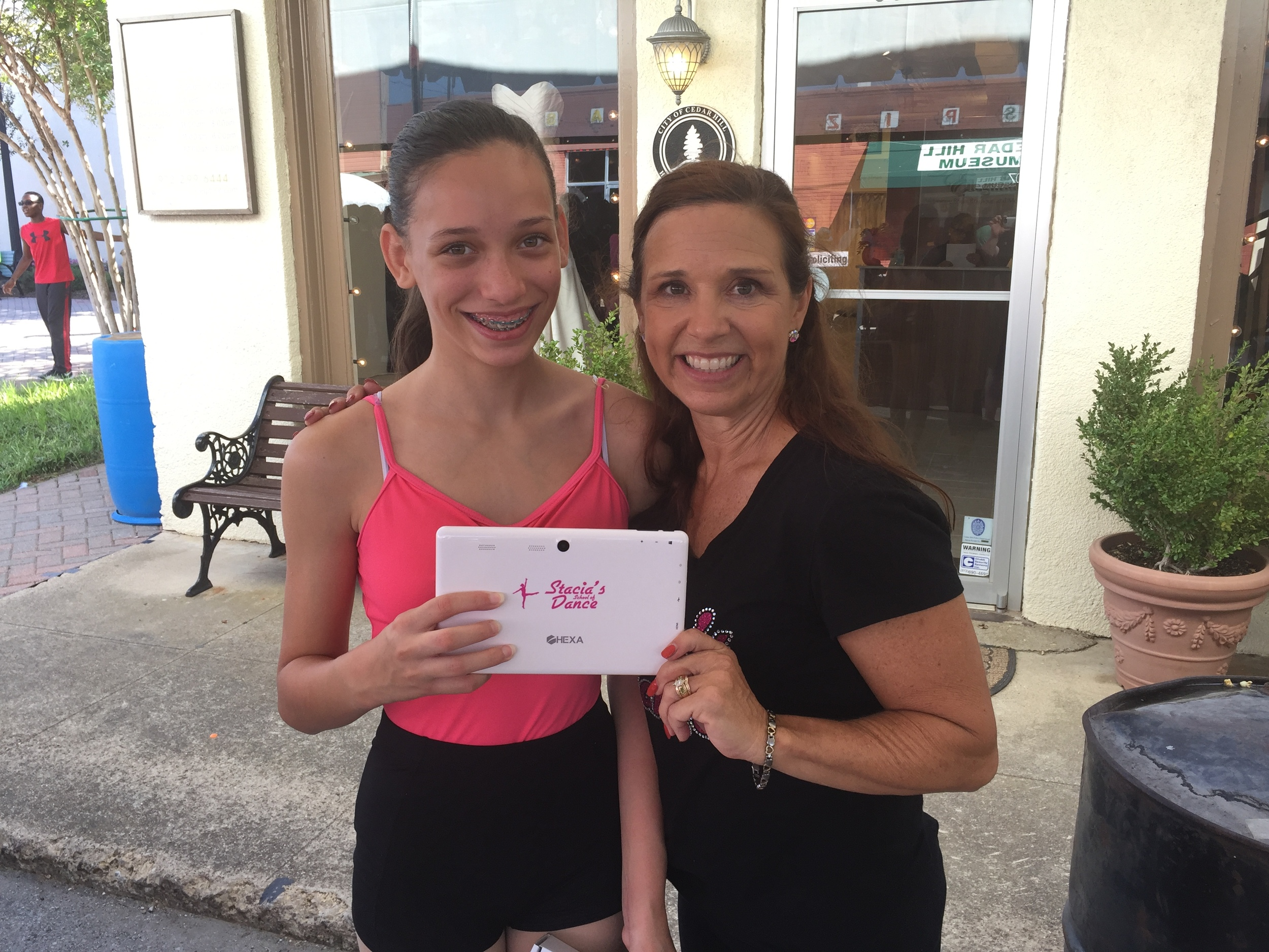 Pictured is Samantha and Stacia just after drawing was held following the studio performance at Cedar Hill Country Day on the Hill.