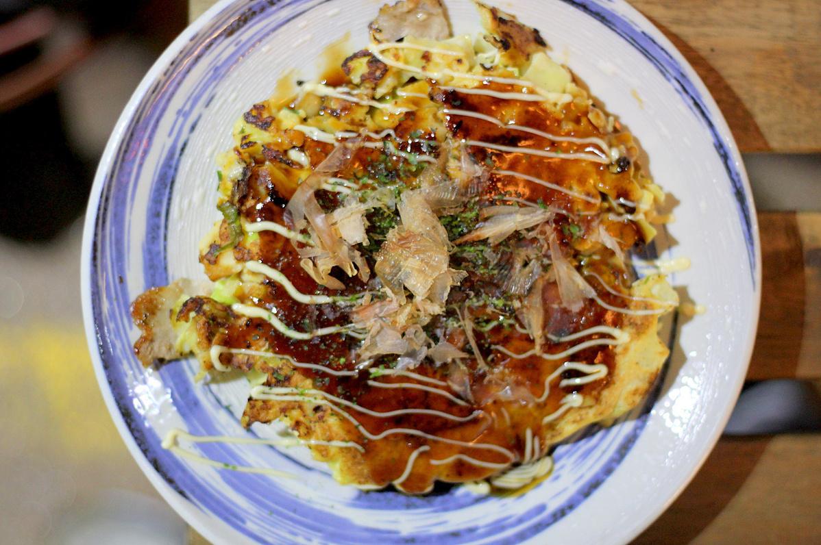 savoury pancake with mayo, brown sauce, seaweed flakes and bonito flakes