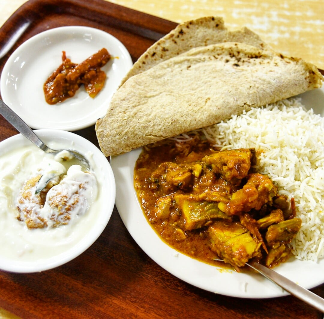 fish curry, dahi vada, lime pickle, rice and chapatti