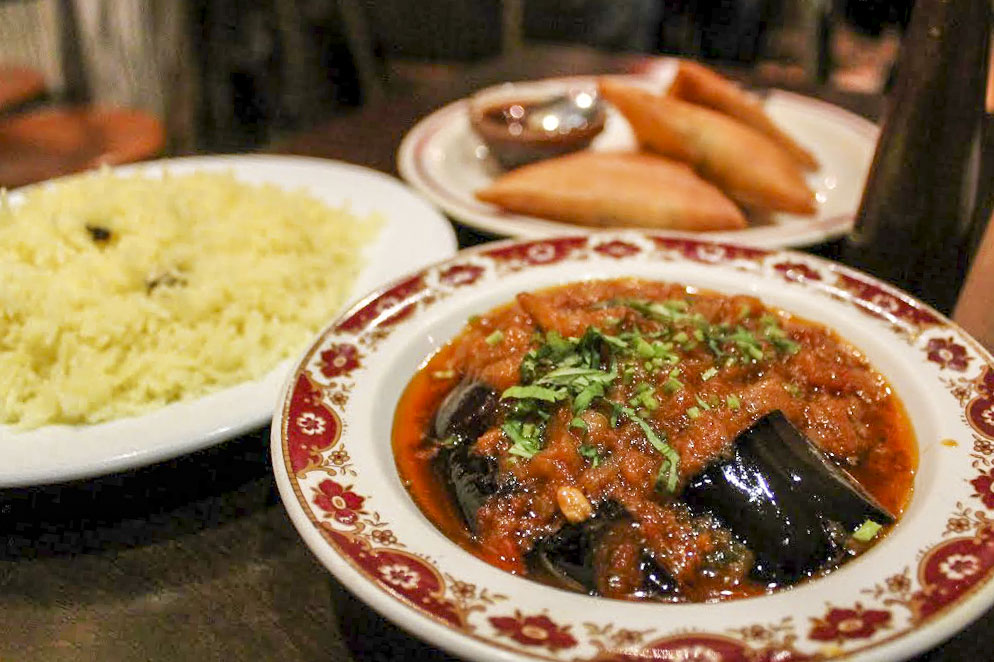 aubergine curry with sides at Jai Krishna