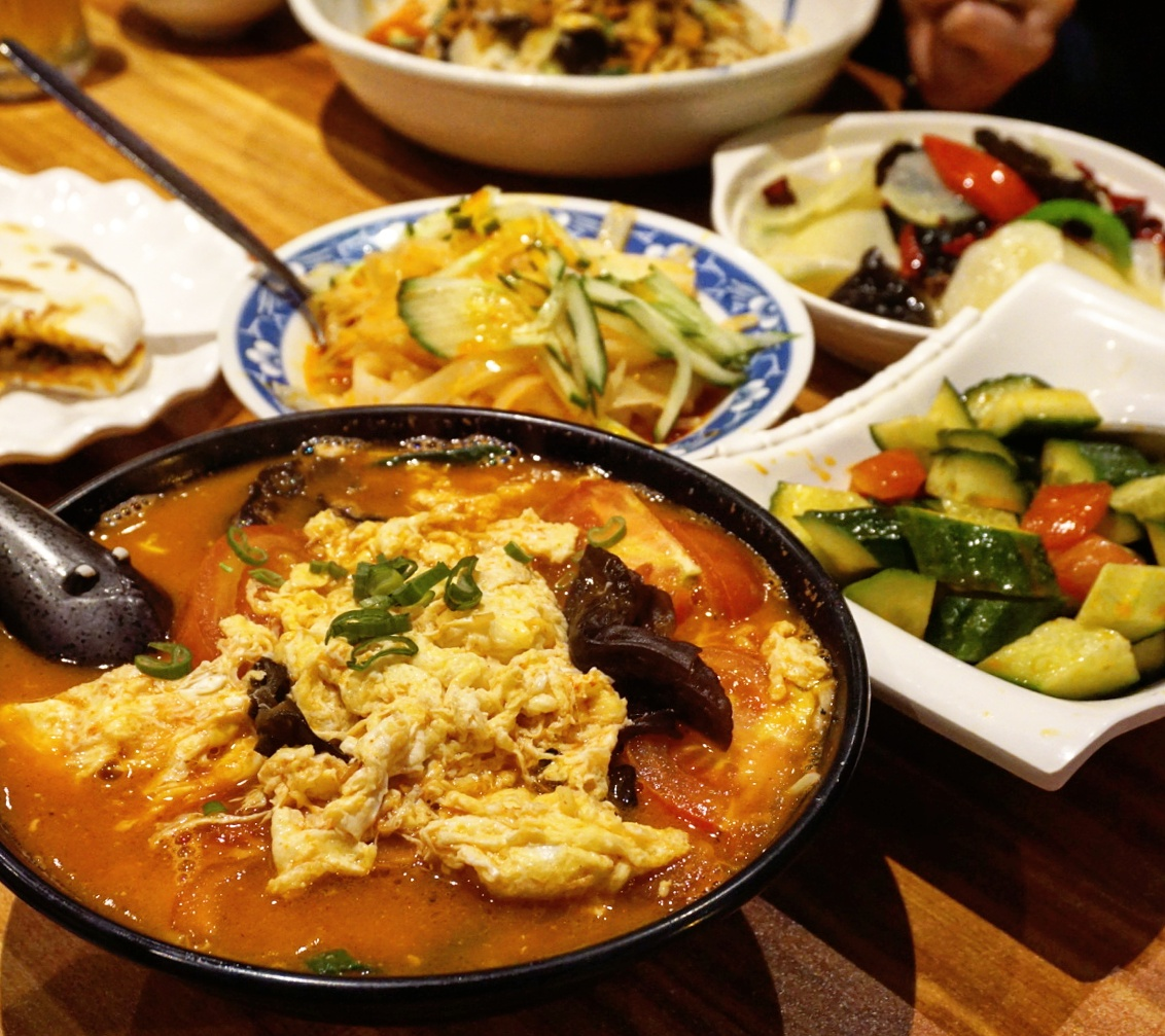 hand-pulled noodles with tomato and egg and a load of starters at Xi'an Impression