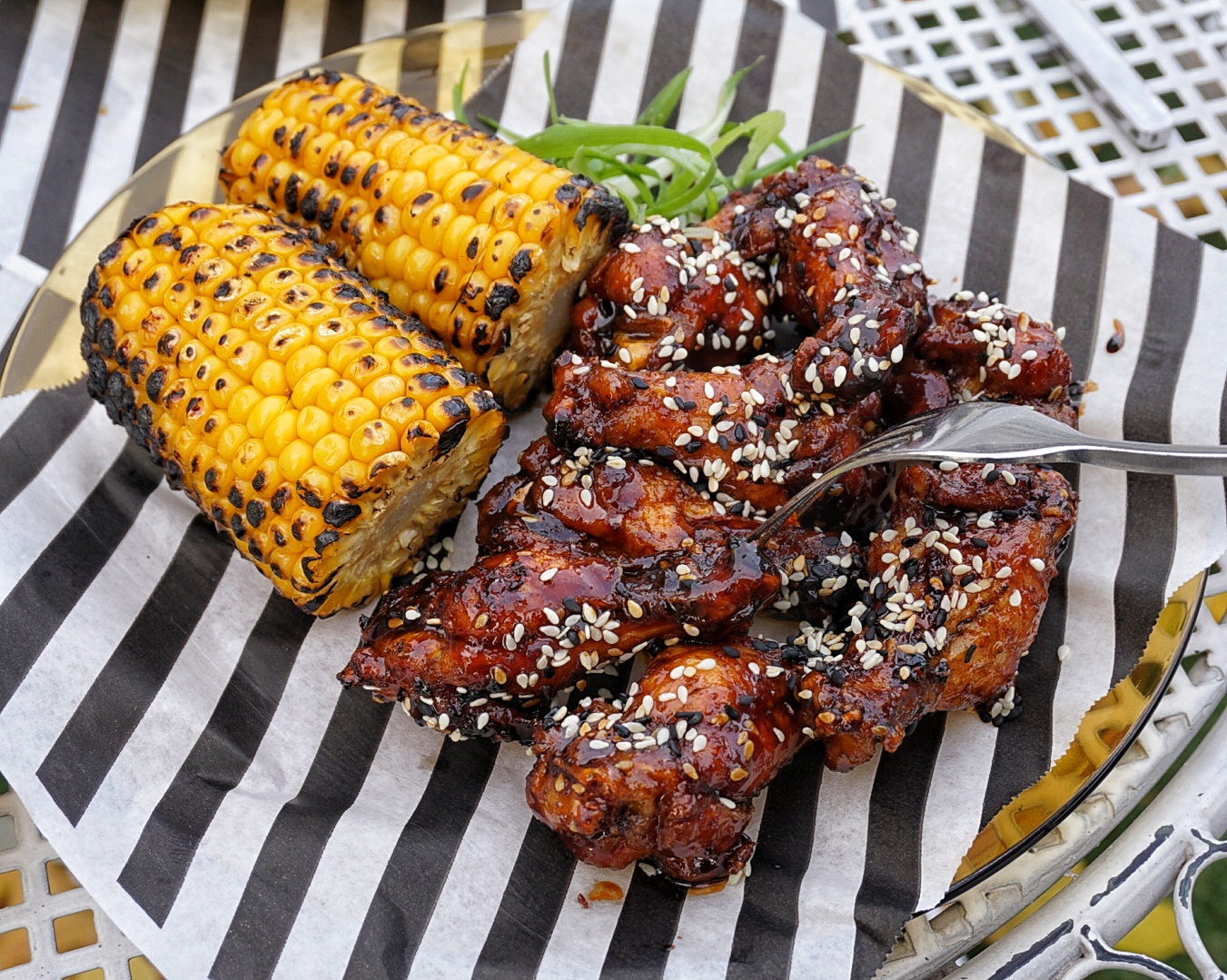 Wings with side of roasted corn with garlic and pepper