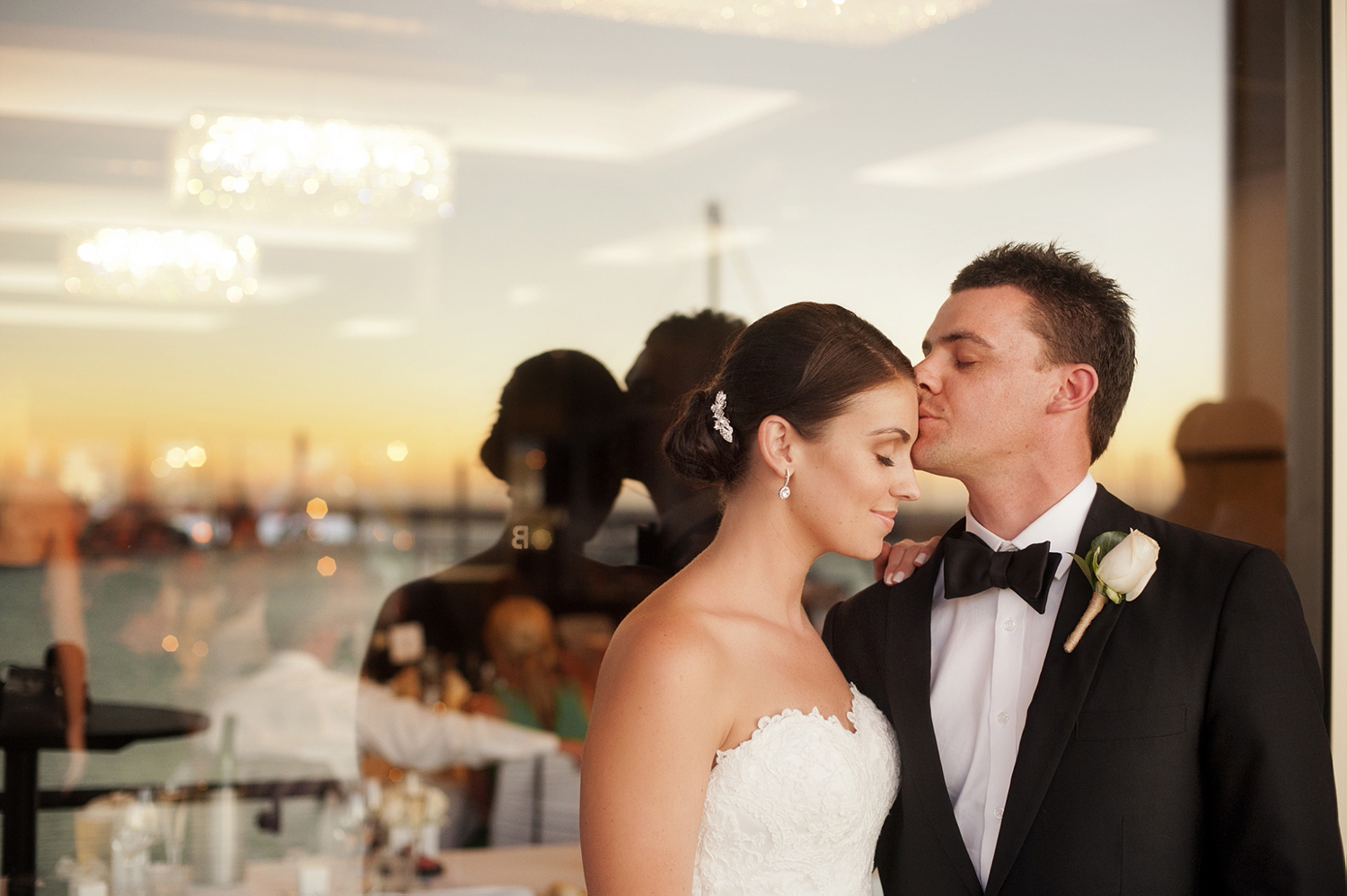 bride and groom at sunset on balcony breakwater perth wedding