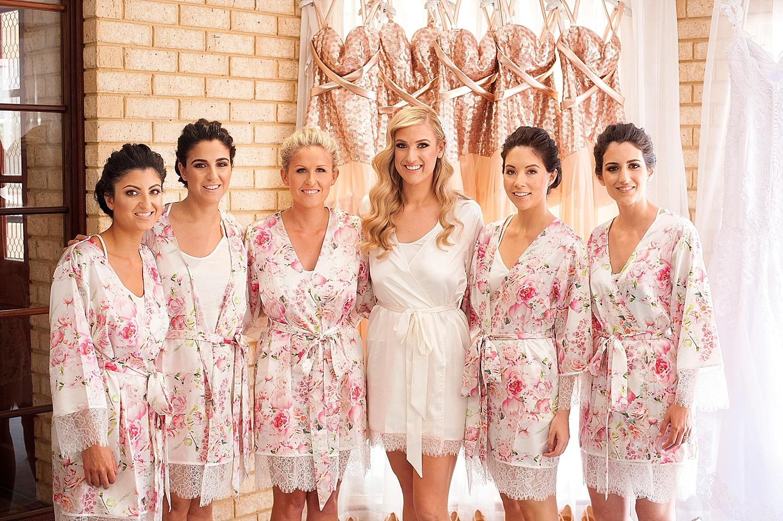 09_bridesmaids in floral robes wedding perth.jpg
