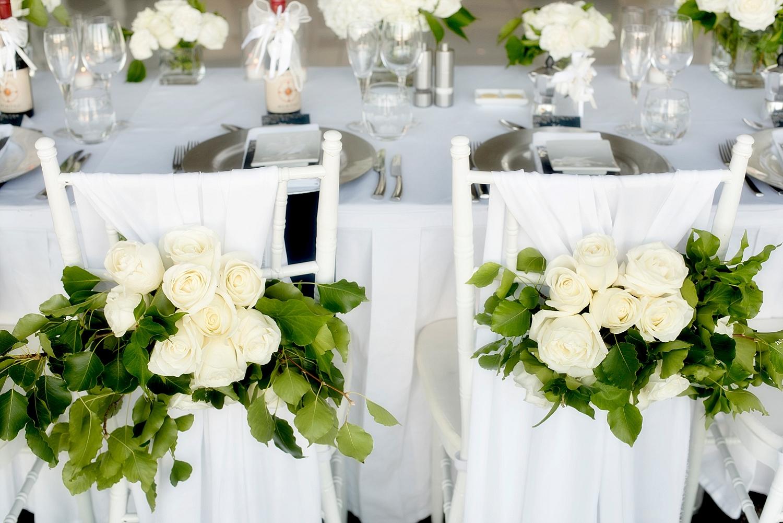 63_mosmans wedding perth flowers on back of chairs.jpg