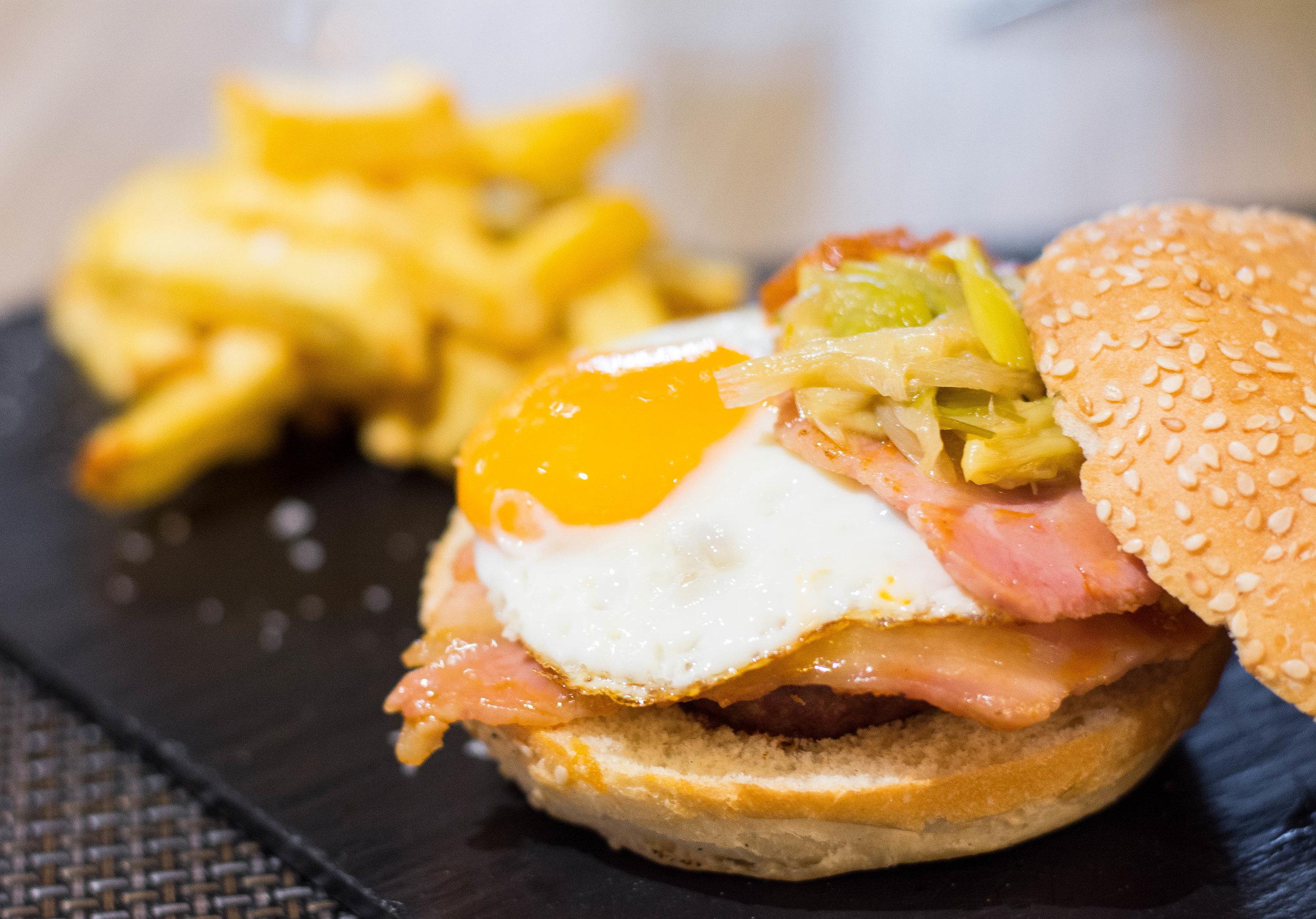 Burger at Le Sense, made with matured meat, calçots and romesco