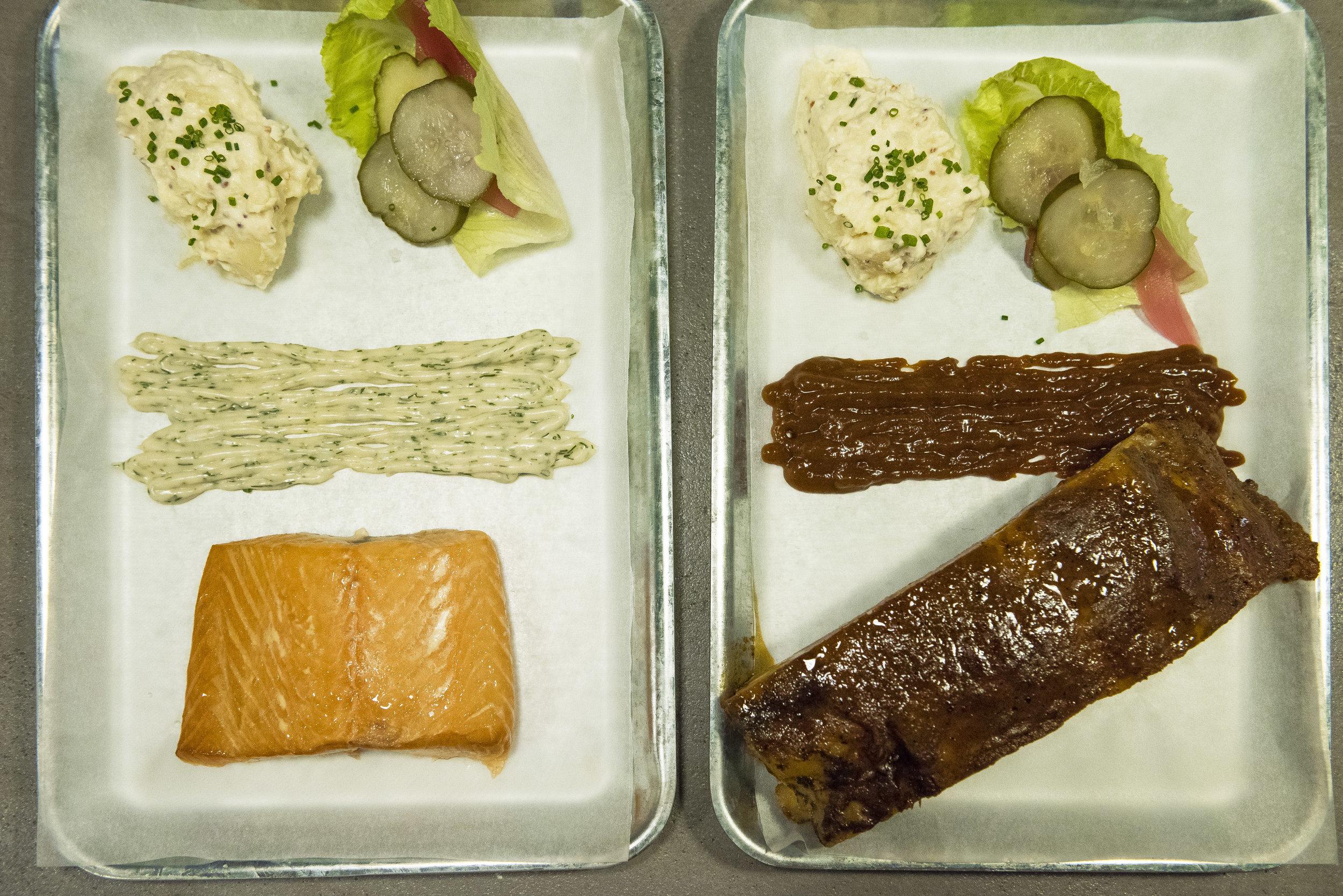 Hot-smoked salmon with dill tartar and potato salad, and smoked ribs with bbq sauce at Olofson, Barcelona. Photo © Barcelona Food Experience