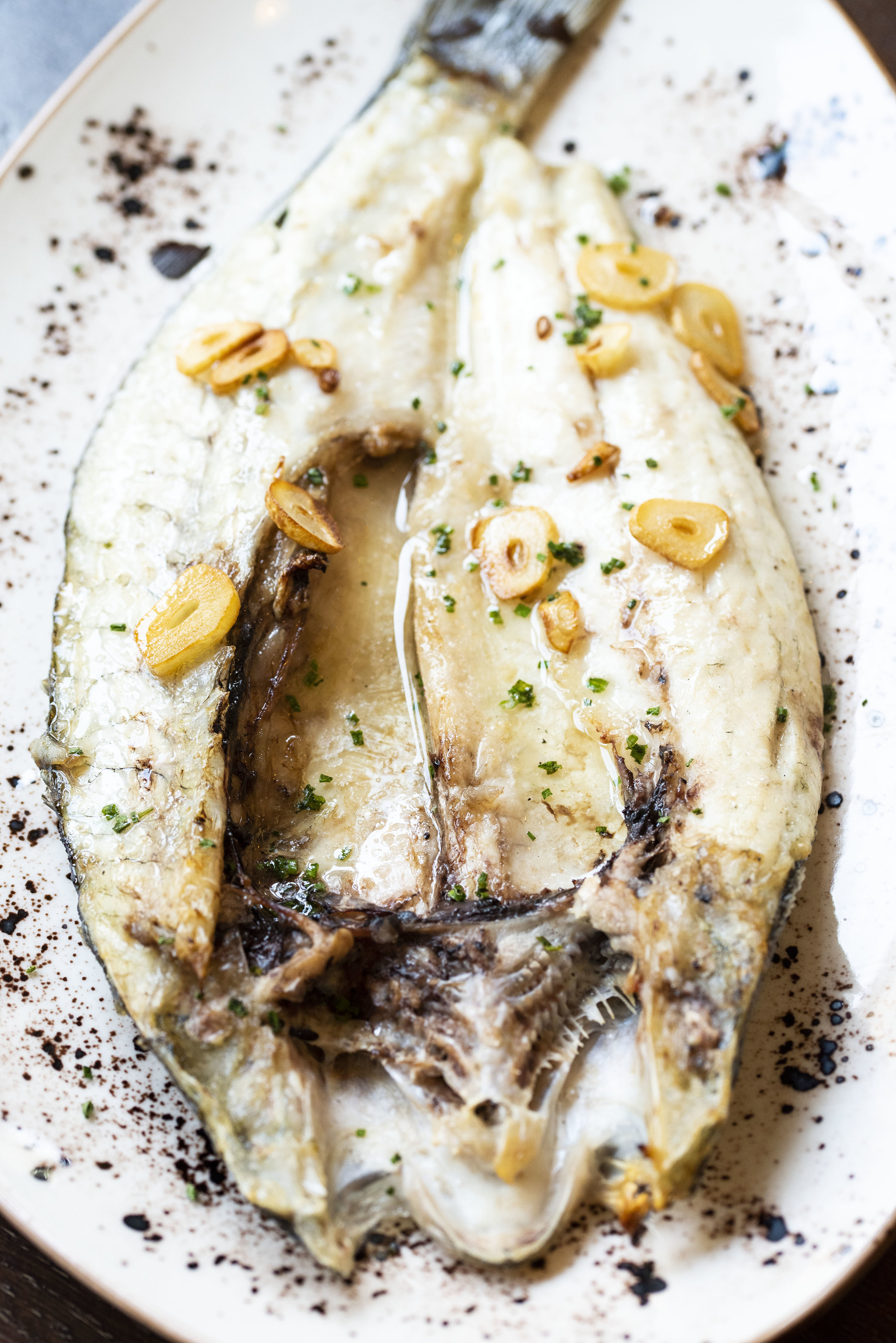 Grilled sea bass at Calabrasa, Barcelona. Photo © Barcelona Food Experience.
