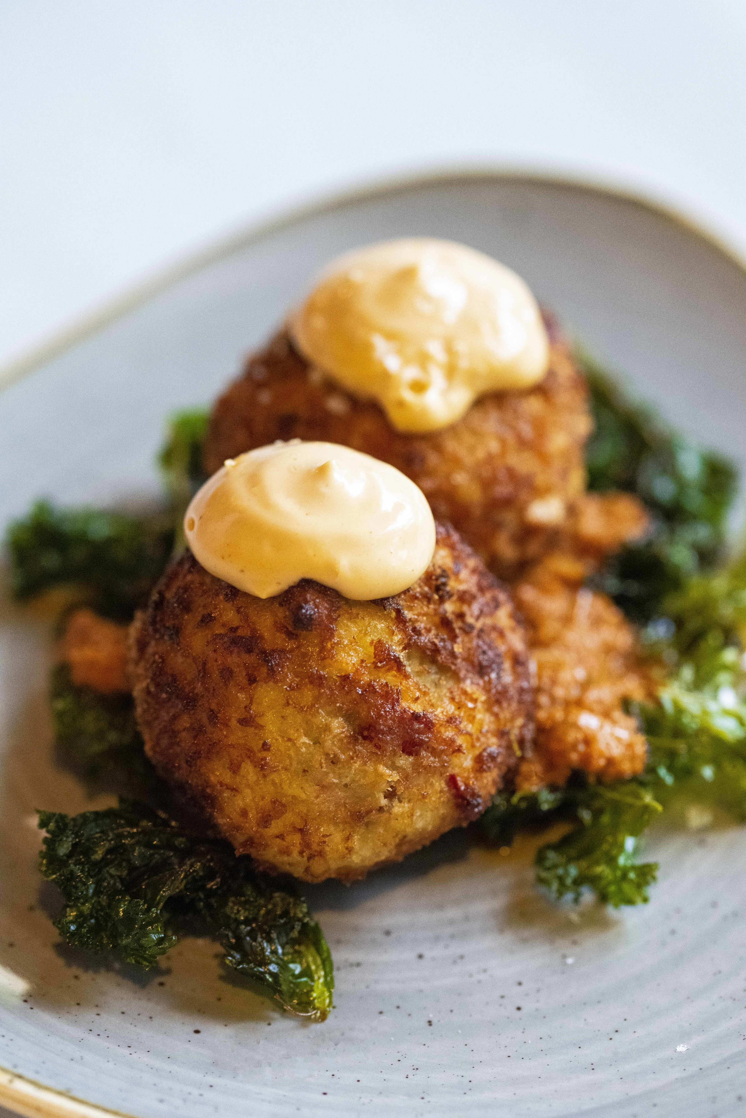 Bombas with kale at Debutis, Barcelona. Photo © Barcelona Food Experience.