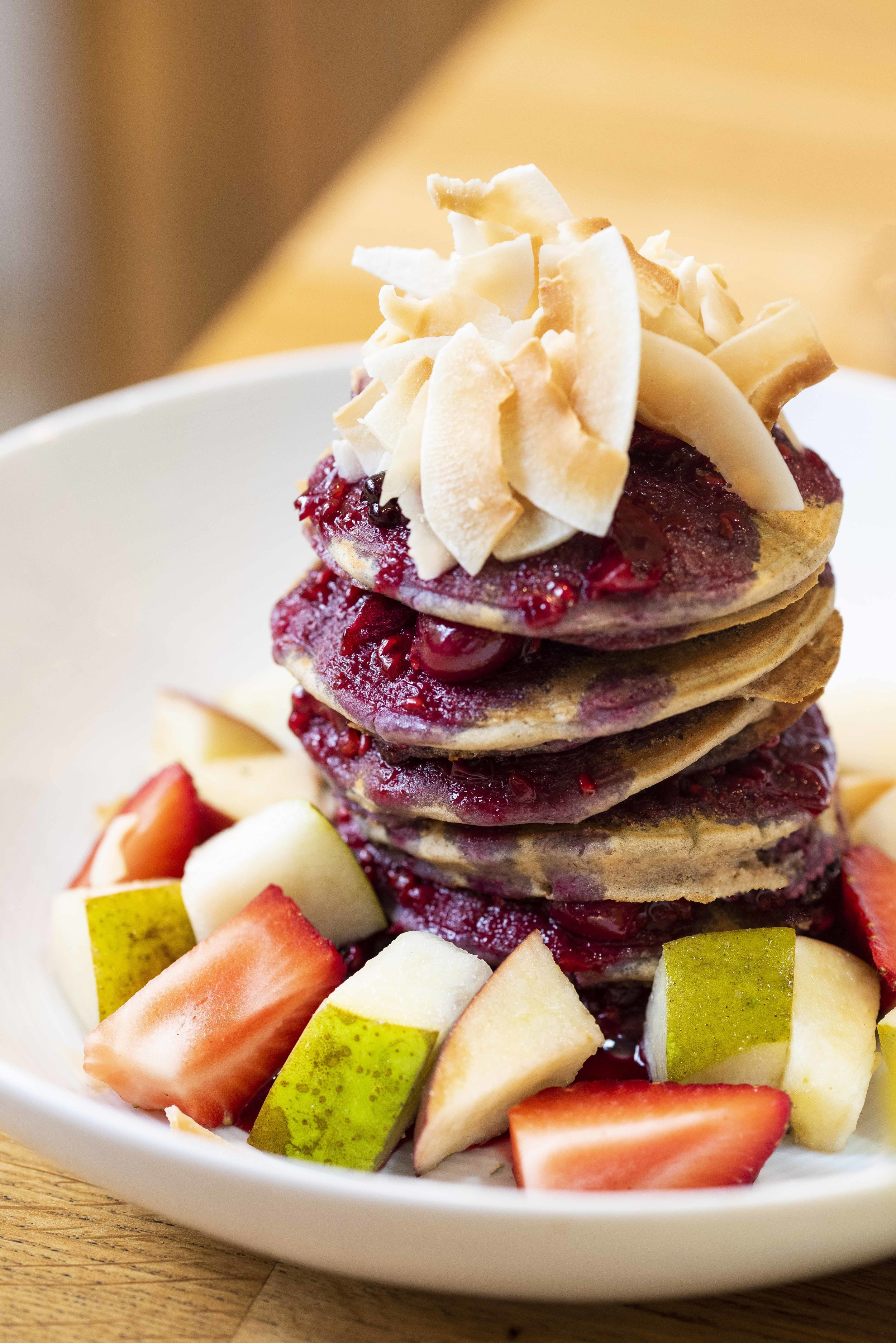 Pancakes with berries and fruit at Equilibrium Cafe, Barcelona. Photo © Barcelona Food Experience.