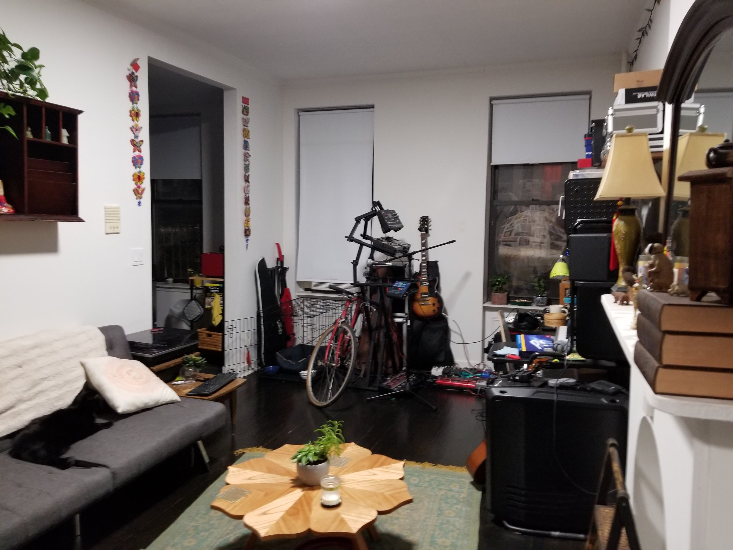 Their living space - fast forward from empty to being cozy and unpacked.